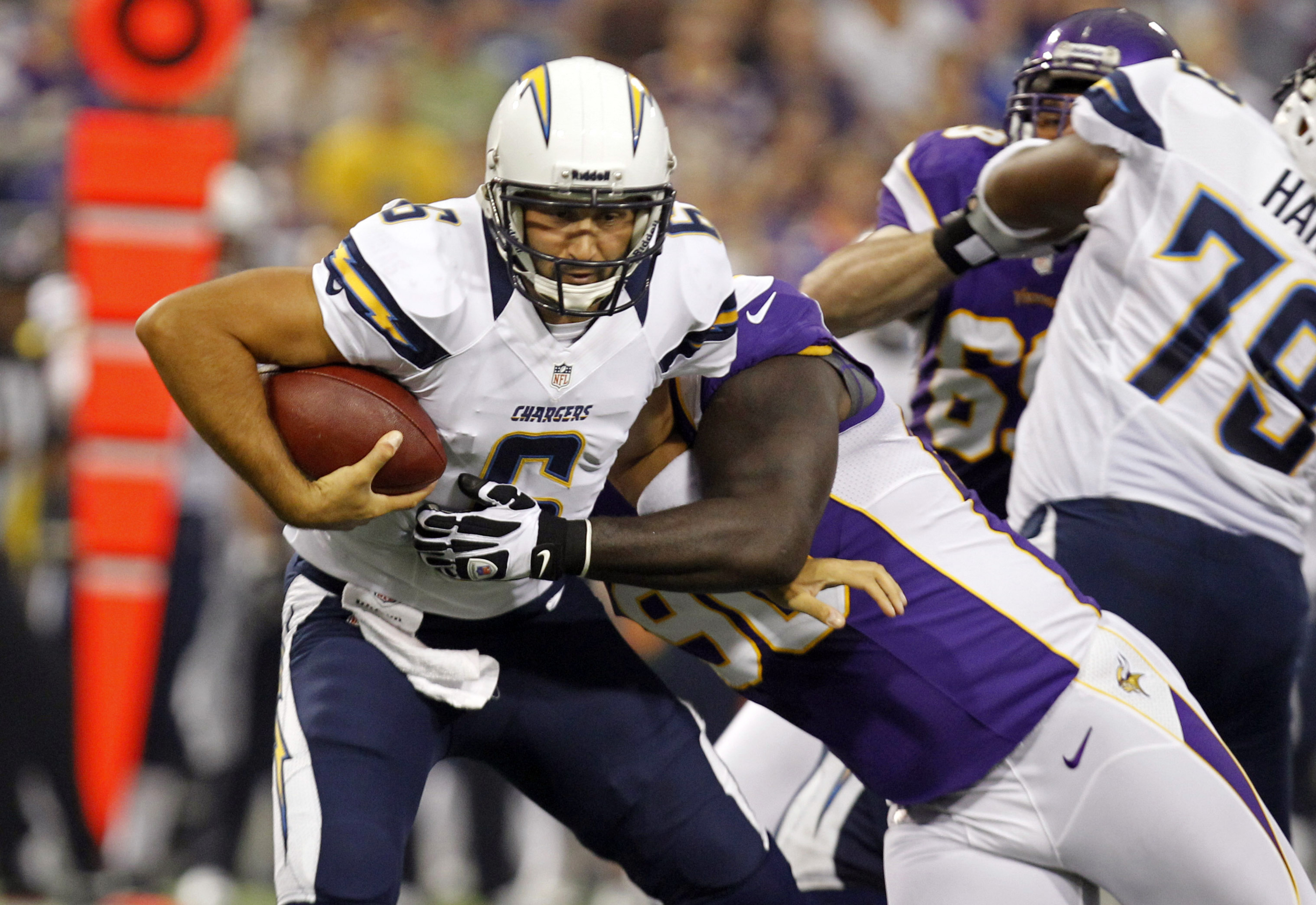 Aug 24, 2012; Minneapolis, MN, USA; Minnesota Vikings defensive tackle Fred Evans (90) sacks San Diego Chargers quarterback Charlie Whitehurst (6) for a 7 yard loss in the first quarter at the Metrodome. Mandatory Credit: Bruce Kluckhohn-US PRESSWIRE
