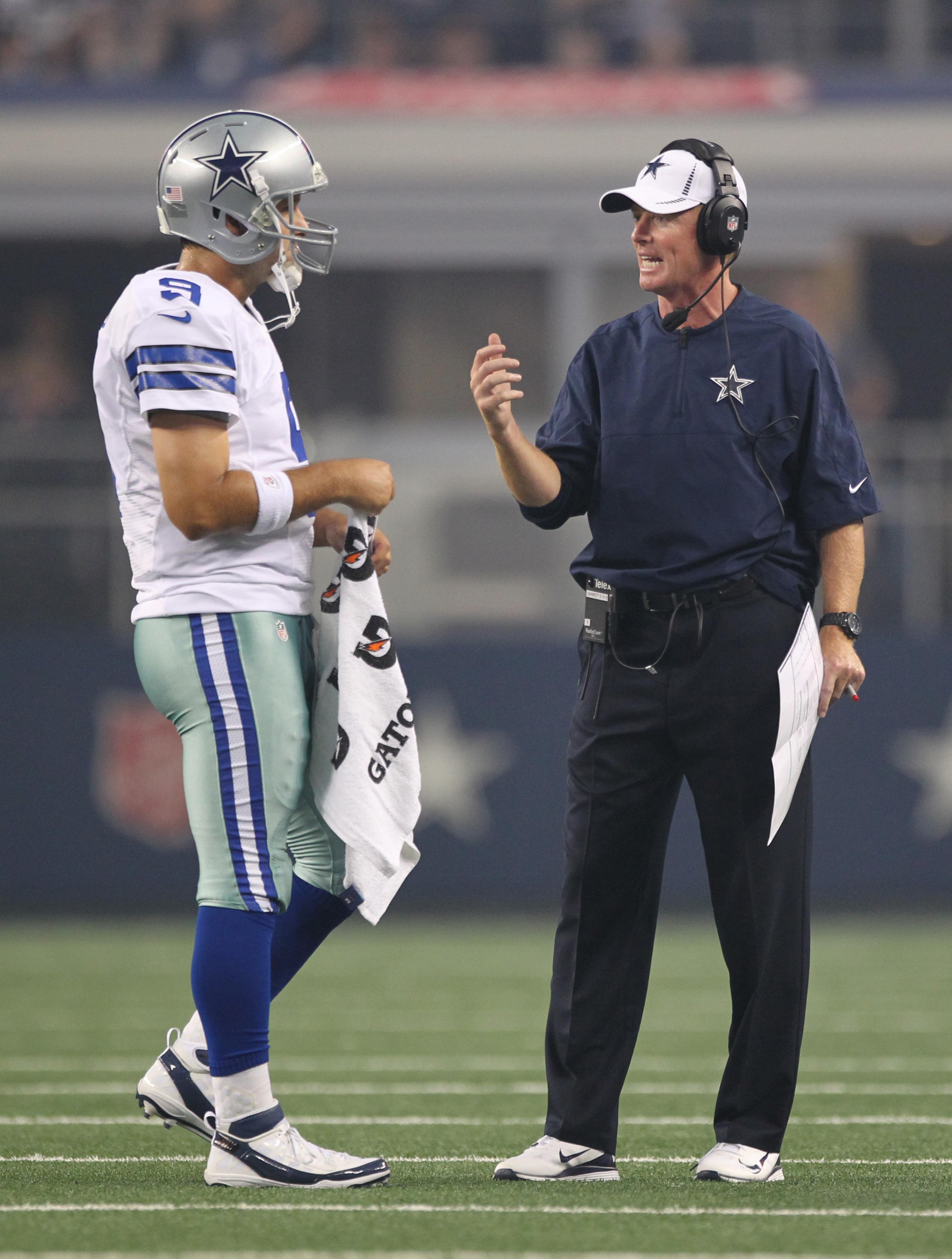 Aug 25, 2012; Arlington, TX, USA; Dallas Cowboys quarterback Tony Romo (9) talks with head coach Jason Garrett during the game against the St Louis Rams at Cowboys Stadium. Mandatory Credit: Matthew Emmons-US PRESSWIRE