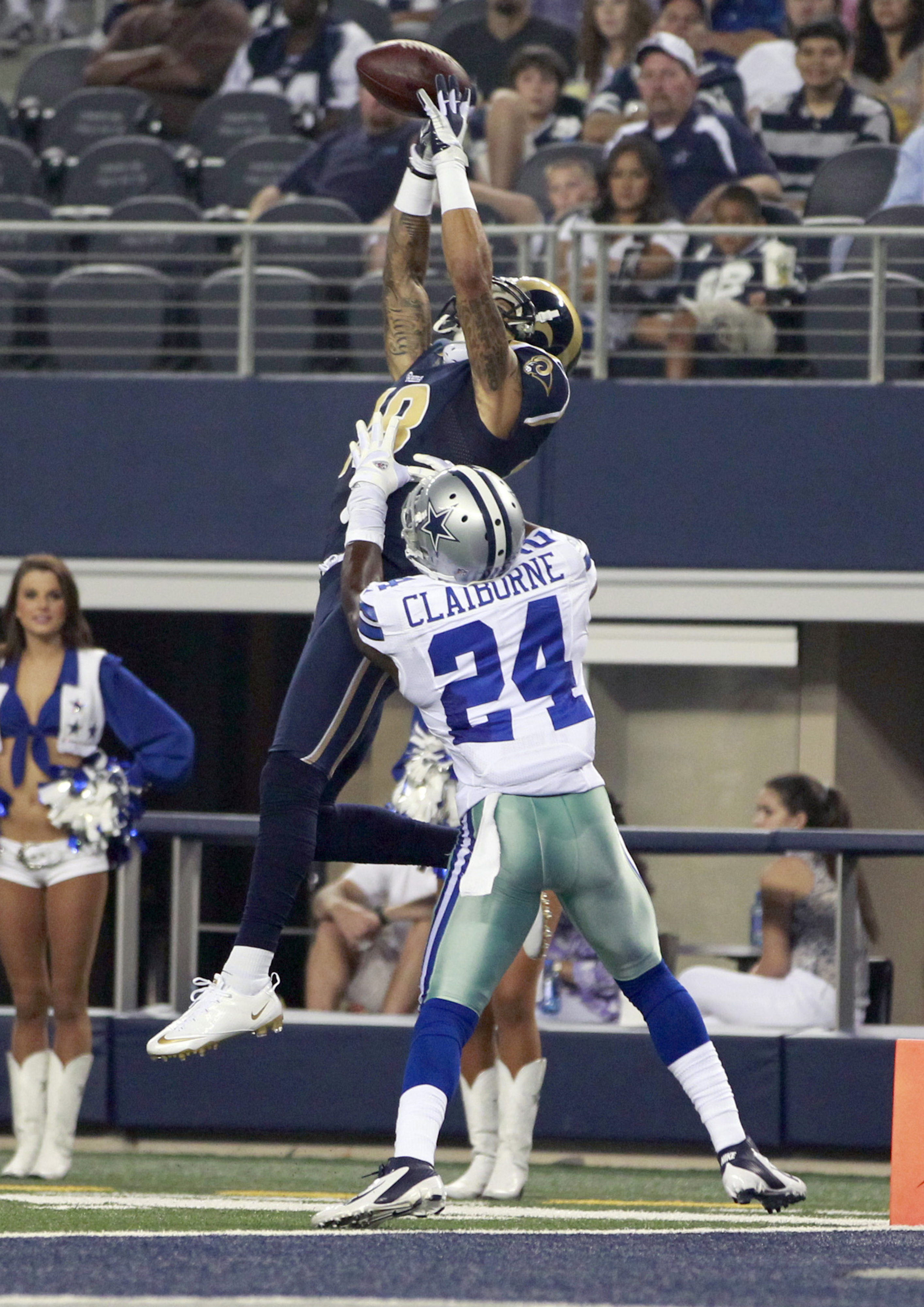 Aug 25, 2012; Arlington, TX, USA; Dallas Cowboys cornerback Morris Claiborne (24) defends a pass against St Louis Rams wide receiver Austin Pettis (18) at Cowboys Stadium. Mandatory Credit: Tim Heitman-US PRESSWIRE