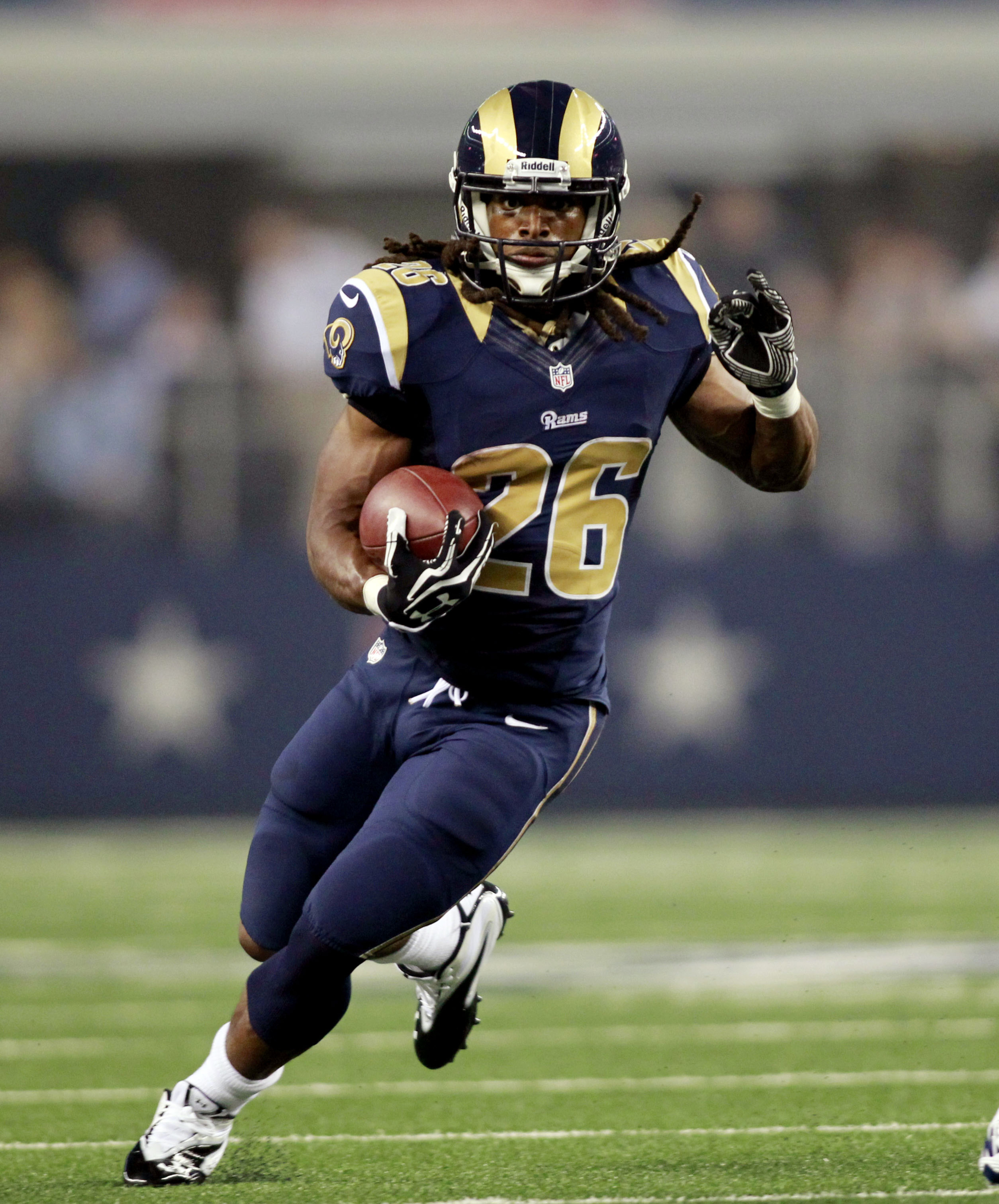 Aug 25, 2012; Arlington, TX, USA; St Louis Rams running back Daryl Richardson (26) carries the ball during the second quarter against the Dallas Cowboys at Cowboys Stadium. Mandatory Credit: Tim Heitman-US PRESSWIRE