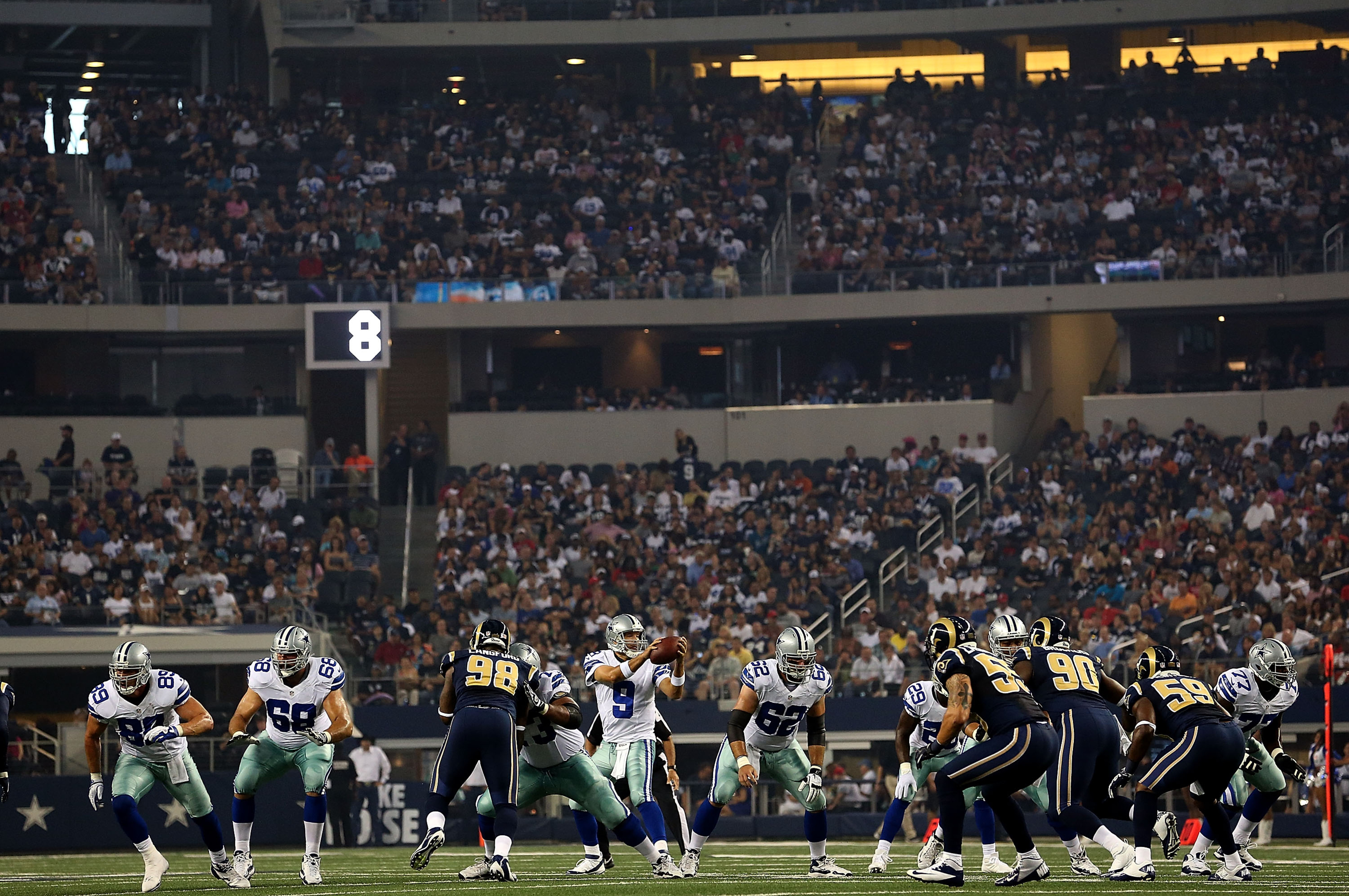 ARLINGTON, TX - AUGUST 25:  Tony Romo #9 of the Dallas Cowboys takes a snap during play against the St. Louis Rams at Cowboys Stadium on August 25, 2012 in Arlington, Texas.  (Photo by Ronald Martinez/Getty Images)