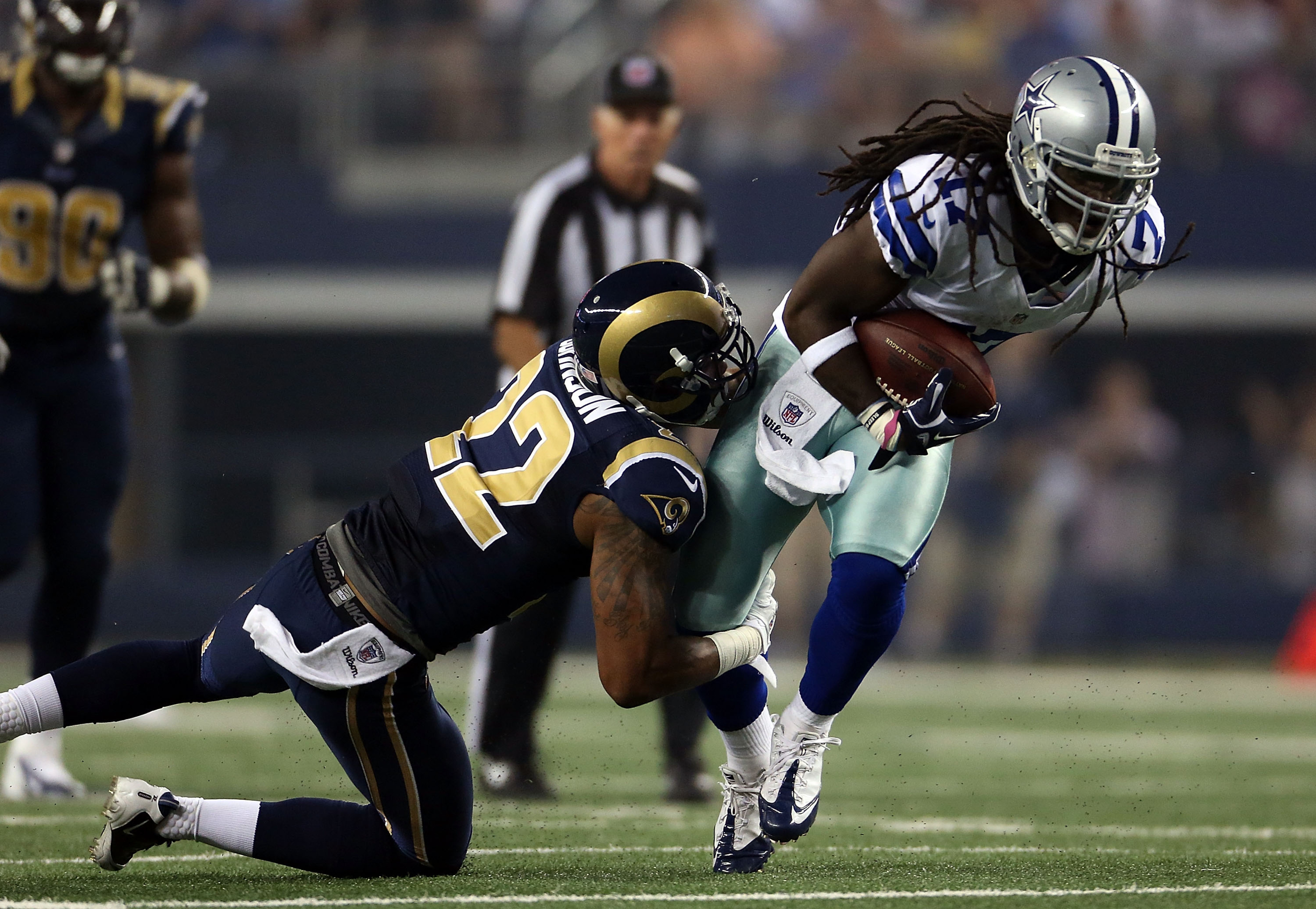 ARLINGTON, TX - AUGUST 25:   Dwayne Harris #17 of the Dallas Cowboys runs the ball against  Trumaine Johnson #22 of the St. Louis Rams at Cowboys Stadium on August 25, 2012 in Arlington, Texas.  (Photo by Ronald Martinez/Getty Images)