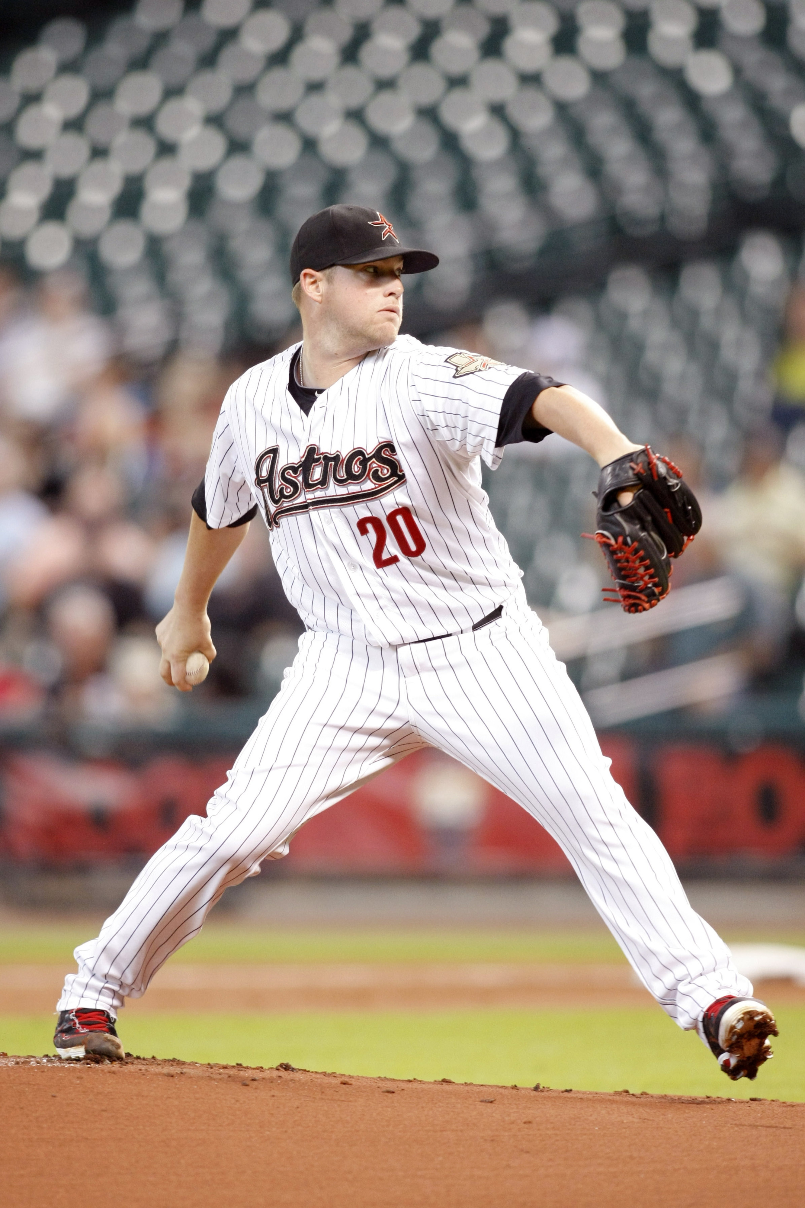 Aug 28, 2012; Houston, TX, USA; Houston Astros starting pitcher Bud Norris (20) throws a pitch against the San Francisco Giants in the first inning at Minute Maid Park. Mandatory Credit: Brett Davis-US PRESSWIRE
