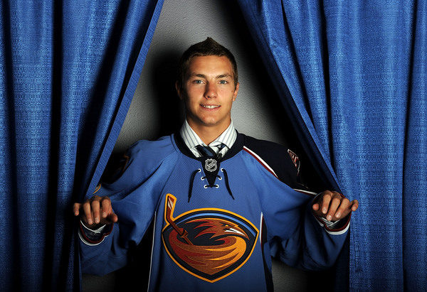 LOS ANGELES, CA - JUNE 25:  Alexander Burmistrov, drafted eighth overall by the Atlanta Thrashers, poses on stage during the 2010 NHL Entry Draft at Staples Center on June 25, 2010 in Los Angeles, California.  (Photo by Harry How/Getty Images)