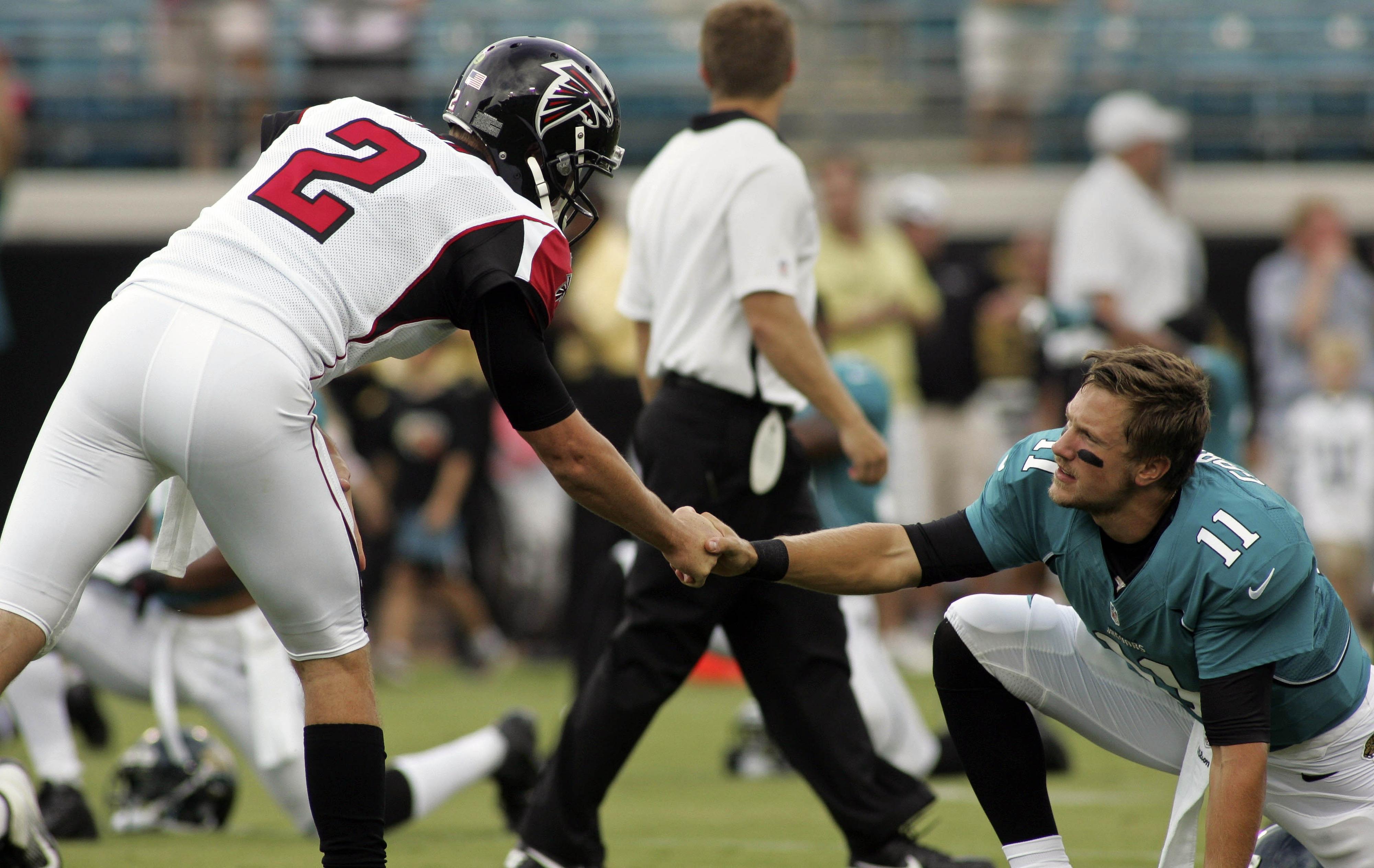 August 30, 2012; Jacksonville FL, USA; Atlanta Falcons quarterback Matt Ryan (2) shakes hands with Jacksonville Jaguars quarterback Blaine Gabbert (11) before the start of their game at EverBank Field. Mandatory Credit: Phil Sears-US PRESSWIRE