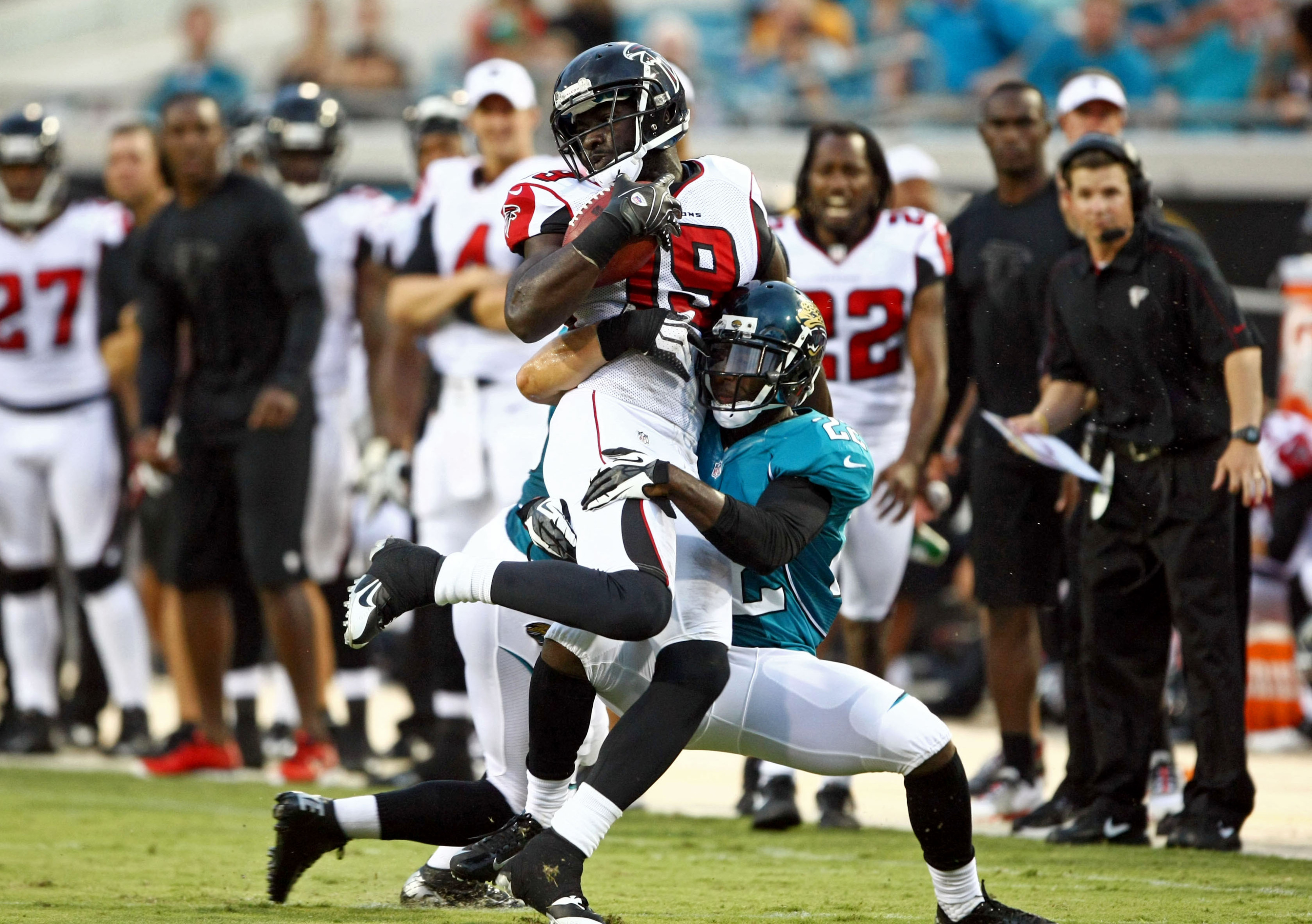 Aug 30, 2012; Jacksonville FL, USA; Jacksonville Jaguars cornerback Kevin Rutland (22) tackles Atlanta Falcons wide receiver D.J. Davis (19) after a reception during the second quarter at EverBank Field. Mandatory Credit: Douglas Jones-US PRESSWIRE