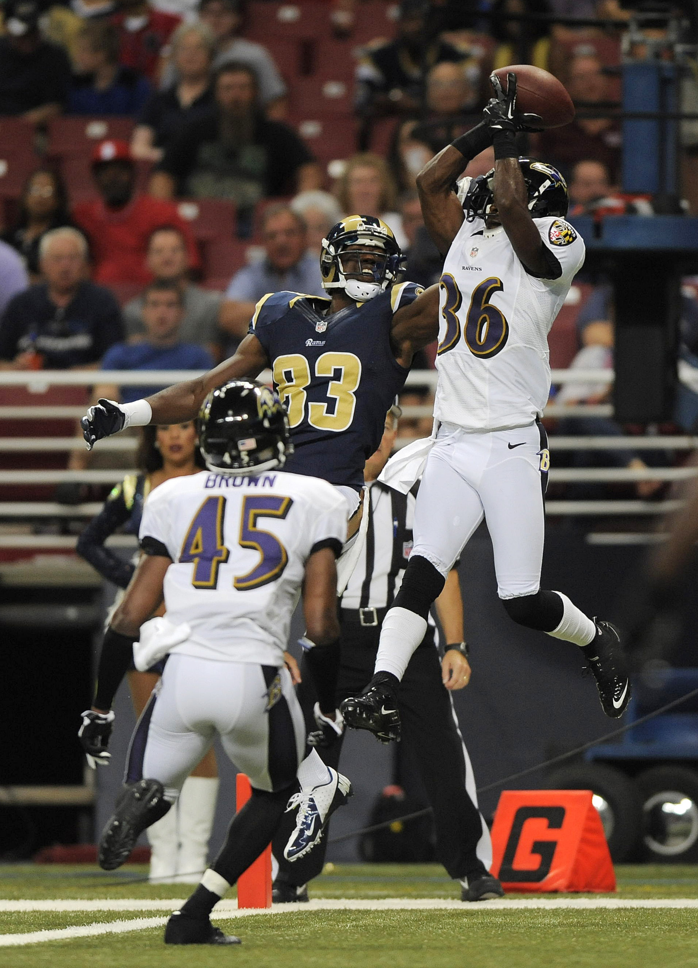 August 30, 2012; St. Louis, MO, USA; Baltimore Ravens cornerback Danny Gorrer (36) intercepts a pass intended for St. Louis Rams wide receiver Brian Quick (83) during the first half at the Edward Jones Dome. Mandatory Credit: Jeff Curry-US PRESSWIRE