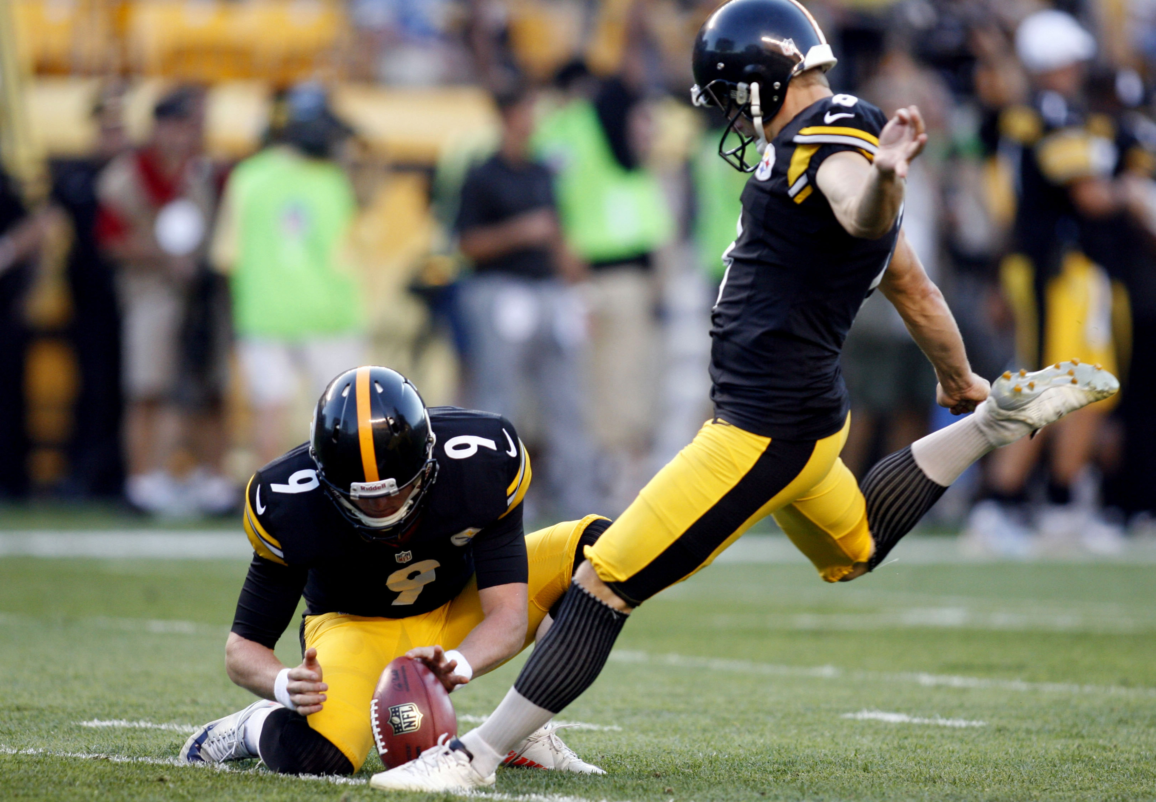 August 30, 2012; Pittsburgh, PA, USA; Pittsburgh Steelers kicker Shaun Suisham (6) kicks an extra point from the hold of Steelers punter Drew Butler (9) against during the first quarter at Heinz Field. Mandatory Credit: Charles LeClaire-US PRESSWIRE