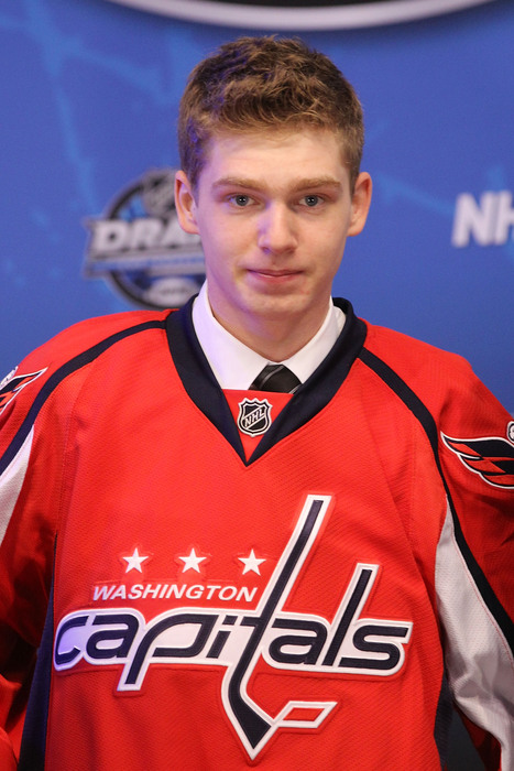 LOS ANGELES, CA - JUNE 25:  Evgeny Kuznetsov, drafted 26th overall by the Washington Capitals, poses on stage during the 2010 NHL Entry Draft at Staples Center on June 25, 2010 in Los Angeles, California.  (Photo by Bruce Bennett/Getty Images)