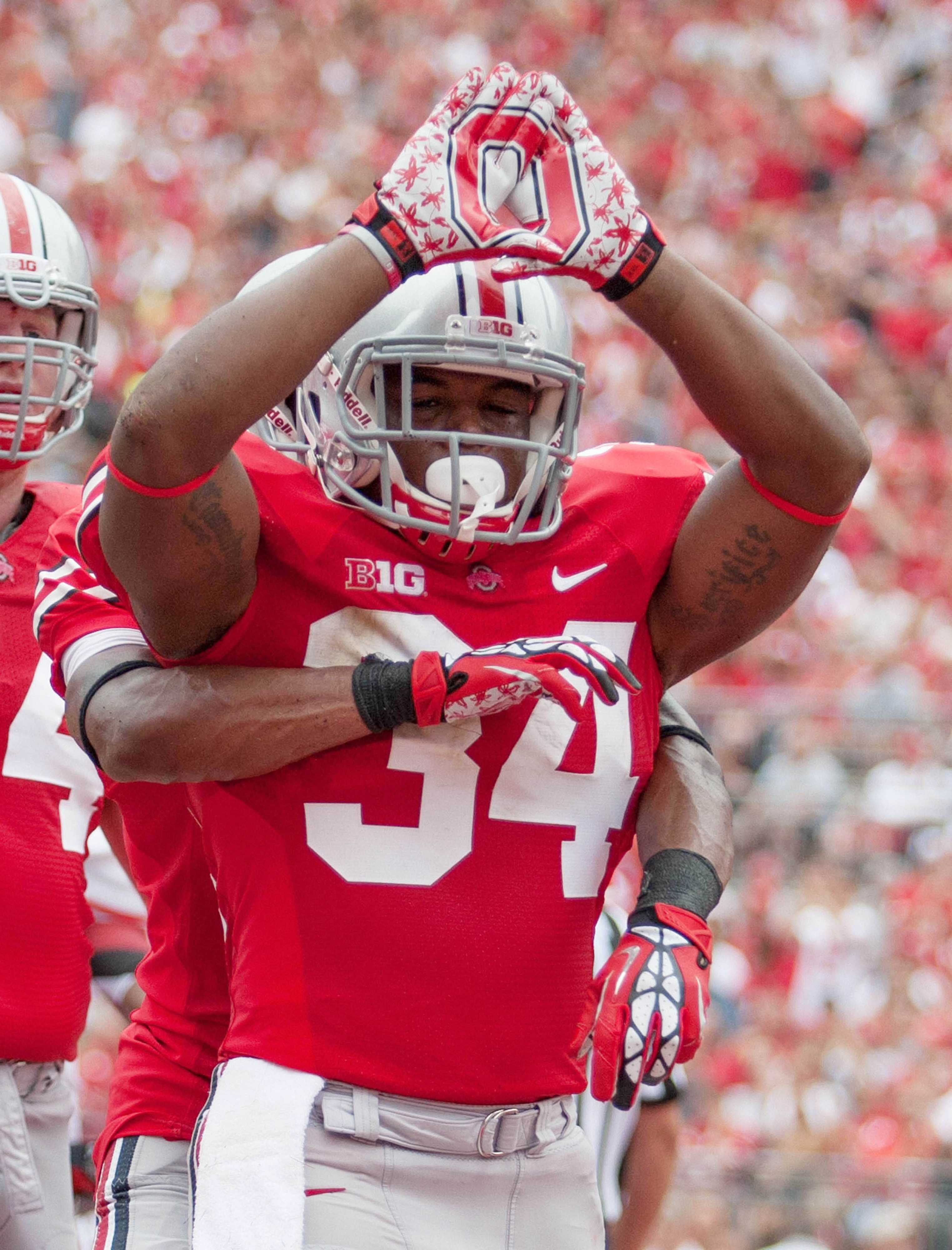 Sept 1, 2012; Columbus, OH, USA; Ohio State Buckeyes running back Carlos Hyde (34) celebrates his touchdown during the second quarter of the game against the Miami Redhawks at Ohio Stadium. Mandatory Credit: Rob Leifheit-US PRESSWIRE