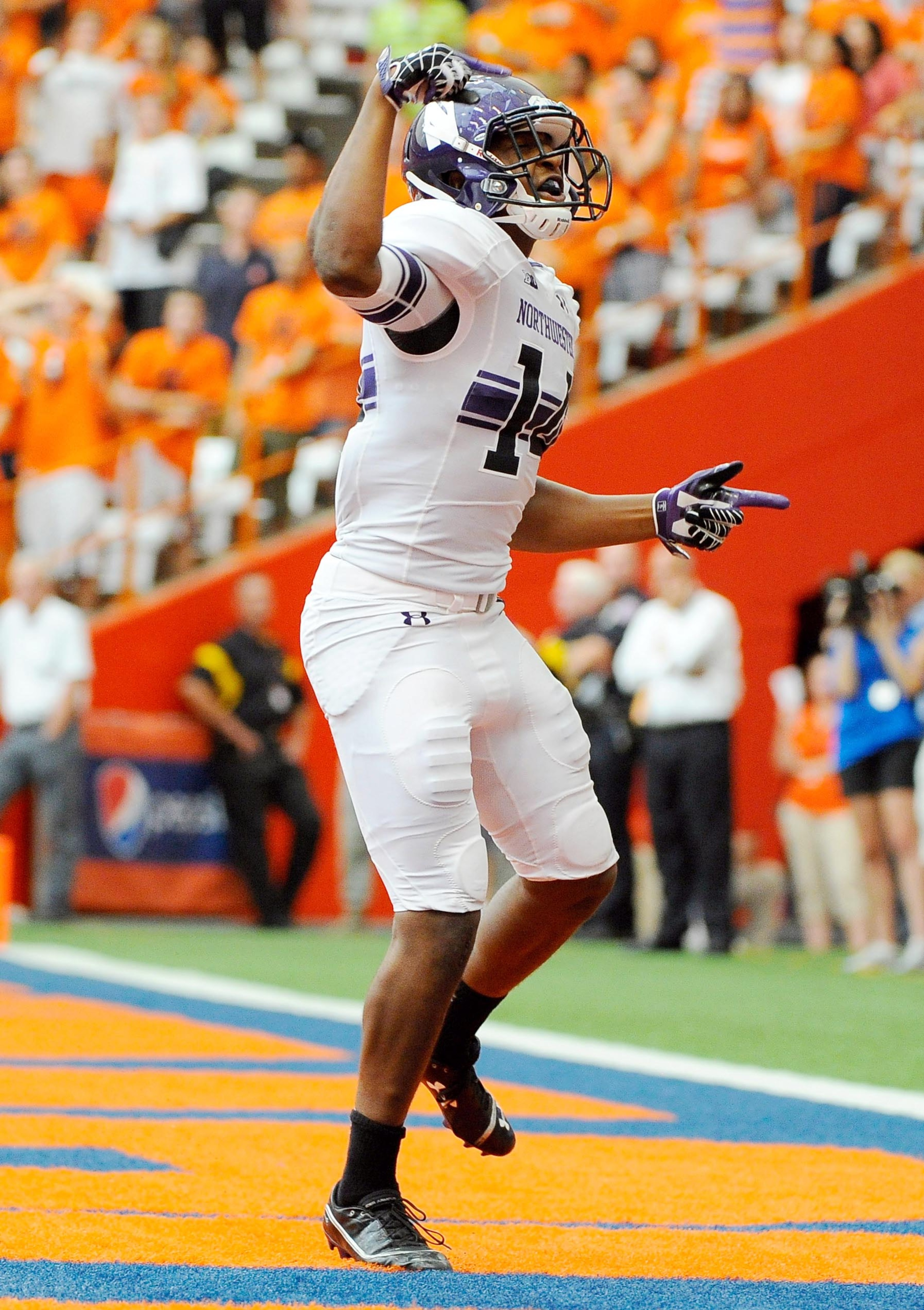 Sep 1, 2012; Syracuse, NY, USA; Northwestern Wildcats wide receiver Christian Jones (14) reacts after scoring a touchdown during the second quarter against the Syracuse Orange at the Carrier Dome. Mandatory Credit: Rich Barnes-US PRESSWIRE