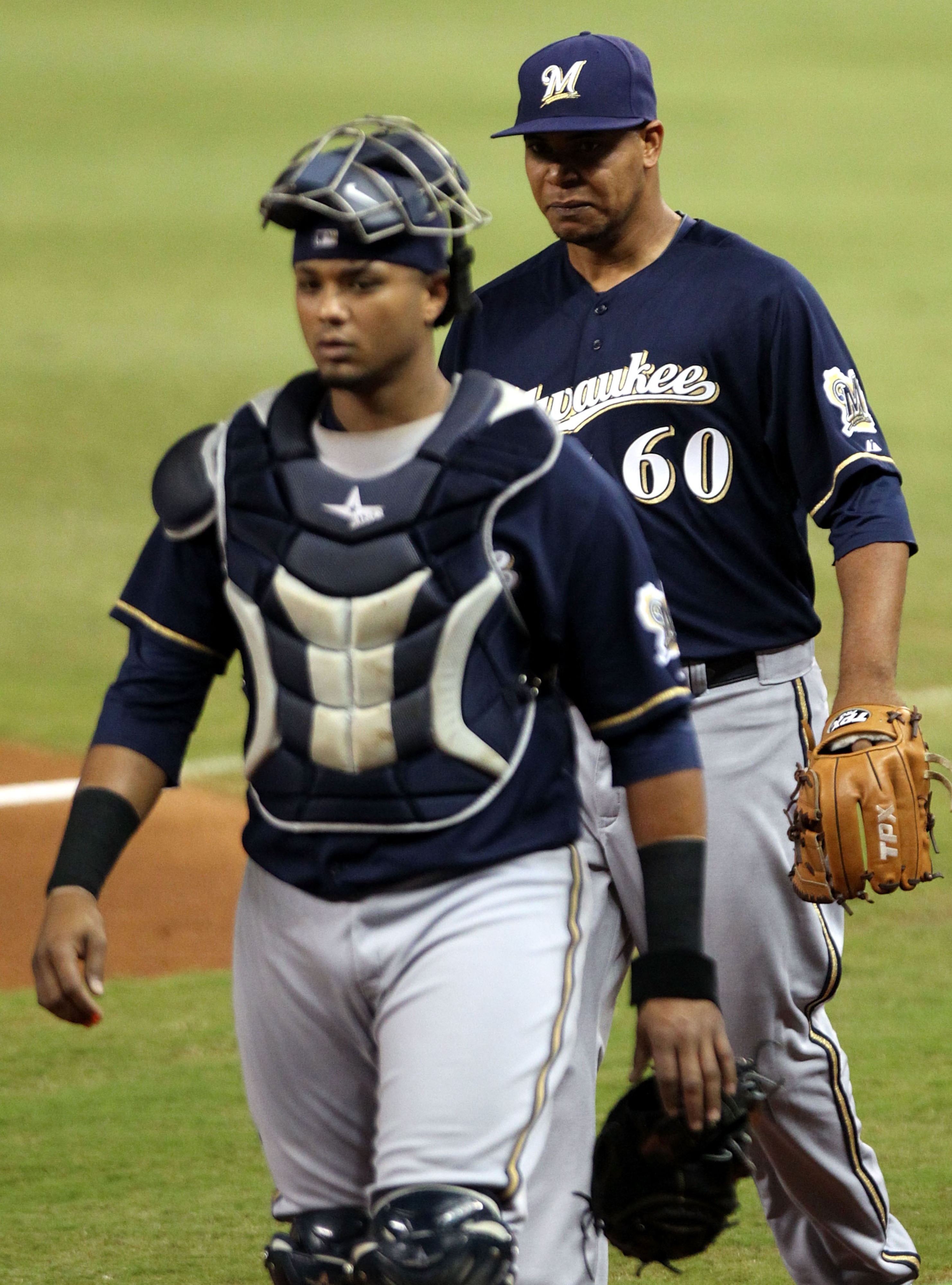 MIAMI, FL - SEPTEMBER 05:  Pitcher Willy Peralta #60 of the Milwaukee Brewers walks with Catcher Martin Maldonado #12 against the Miami Marlins at Marlins Park on September 5, 2012 in Miami, Florida.  (Photo by Marc Serota/Getty Images)