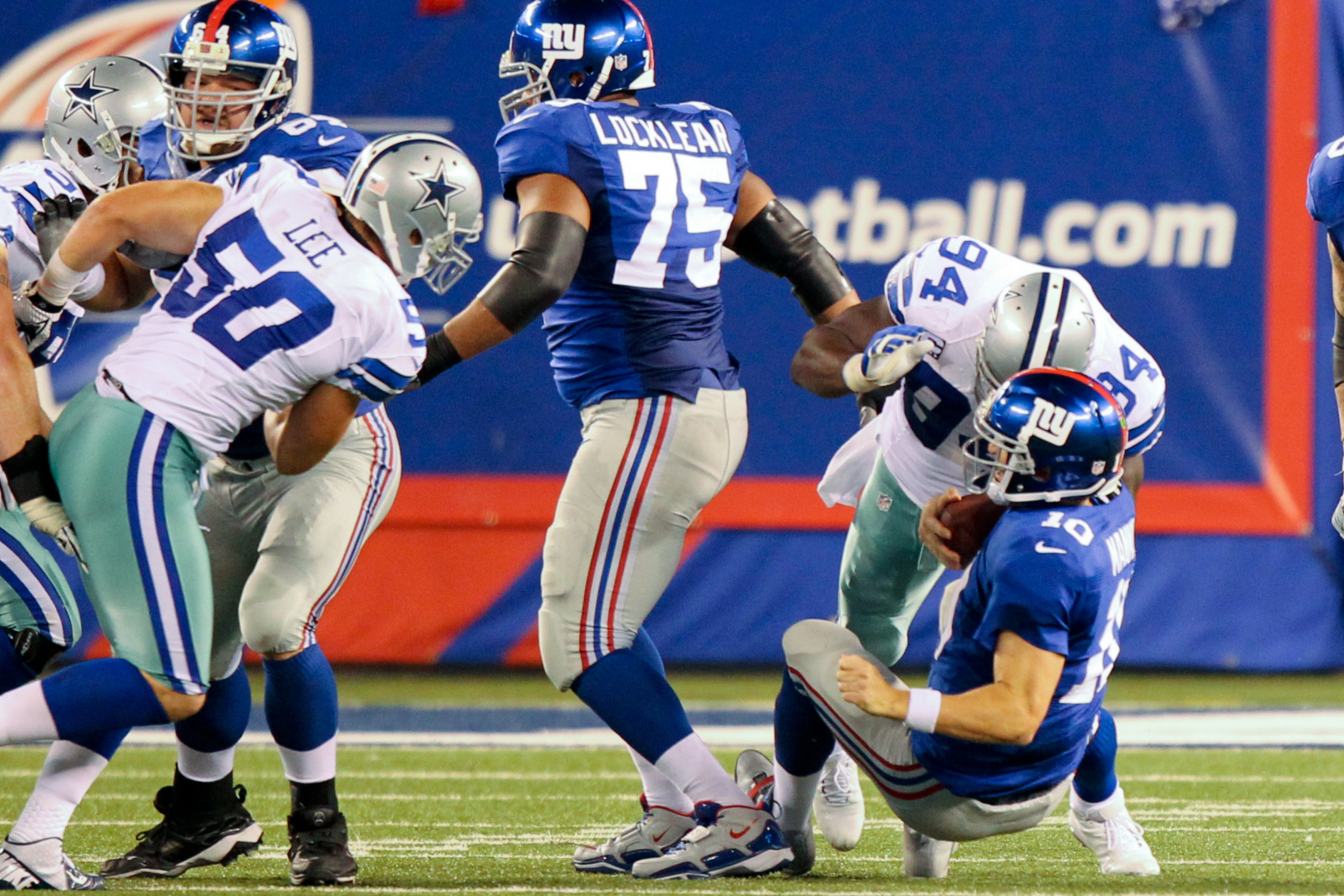 Sep 5, 2012; East Rutherford, NJ, USA;  New York Giants quarterback Eli Manning (10) gets sacked by Dallas Cowboys linebacker DeMarcus Ware (94) during the second quarter at MetLife Stadium. Mandatory Credit: Anthony Gruppuso-US PRESSWIRE