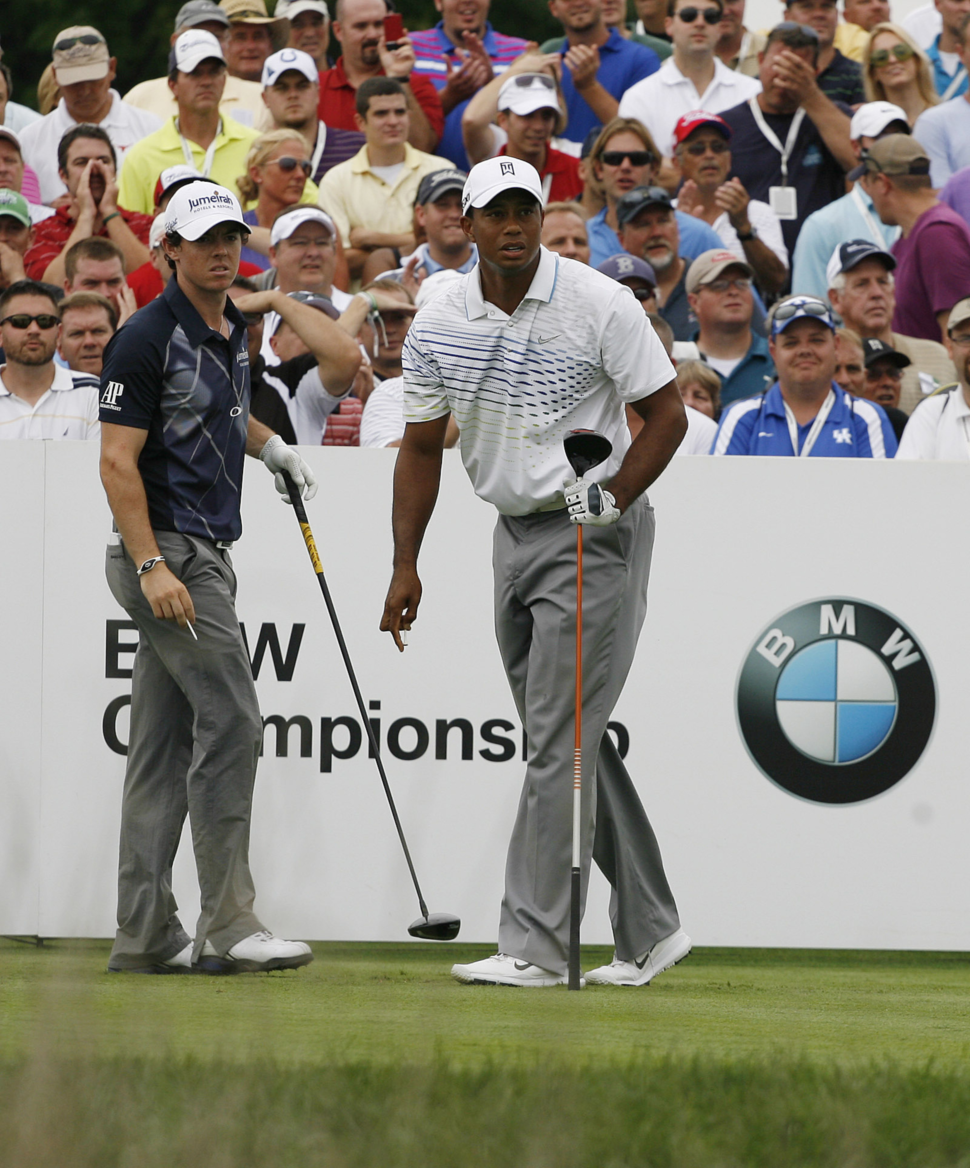 Sep 7, 2012; Carmel, IN, USA; Tiger Woods (right) and Rory McIlroy (left) watch where Tiger's drive lands on the 18th hole during the second round of the BMW Championship at Crooked Stick Golf Club. Mandatory Credit: Brian Spurlock-US PRESSWIRE
