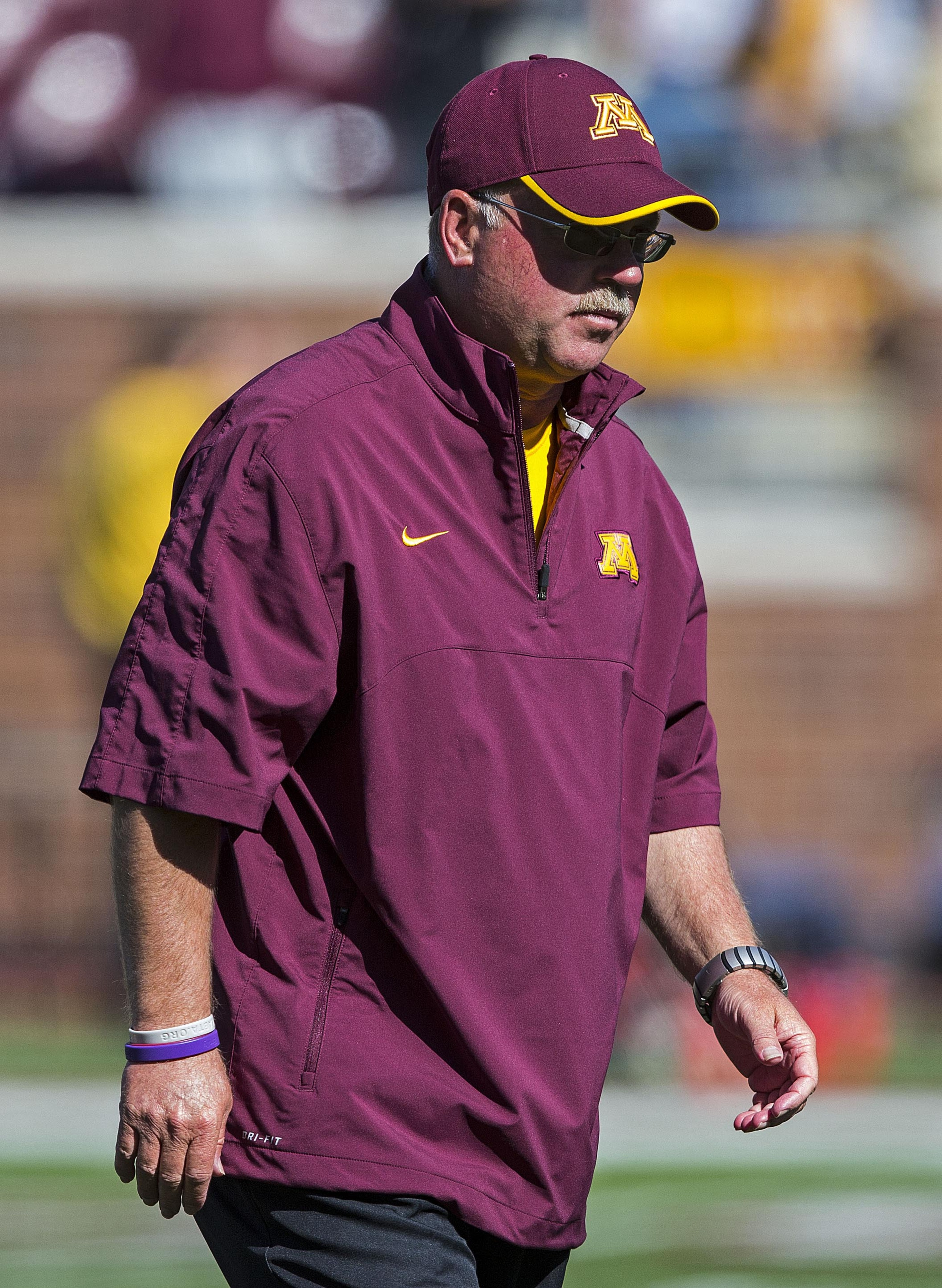 Sept 8, 2012; Minneapolis, MN, USA: Minnesota Gophers head coach Jerry Kill walks off the field before a game against the New Hampshire Wildcats at TCF Bank Stadium. Mandatory Credit: Jesse Johnson-US PRESSWIRE