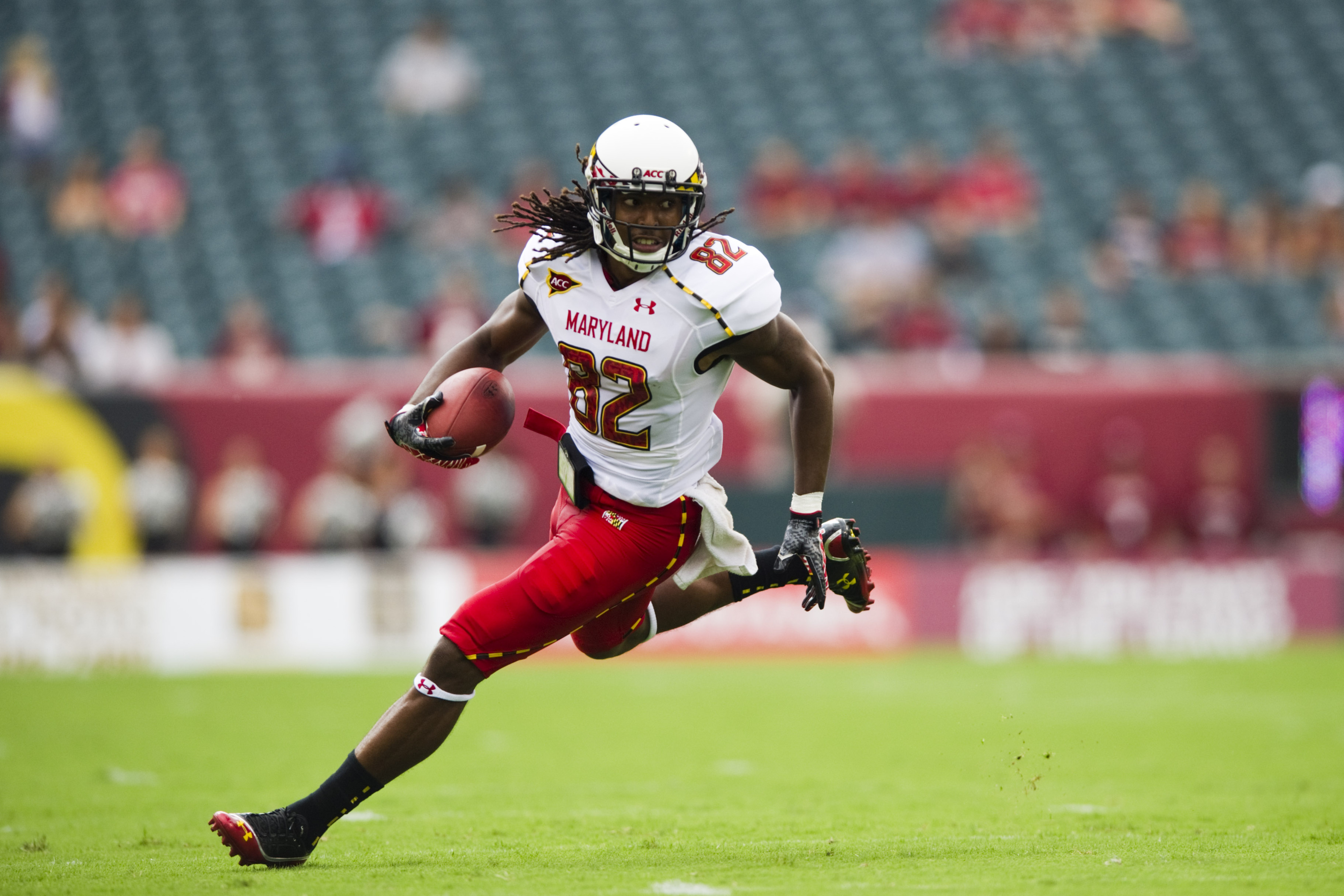 Sep 08, 2012; Philadelphia, PA, USA; Maryland Terrapins wide receiver  Marcus Leak (82) carries the ball during the first quarter against the Temple Owls at Lincoln Financial Field. Mandatory Credit: Howard Smith-US PRESSWIRE