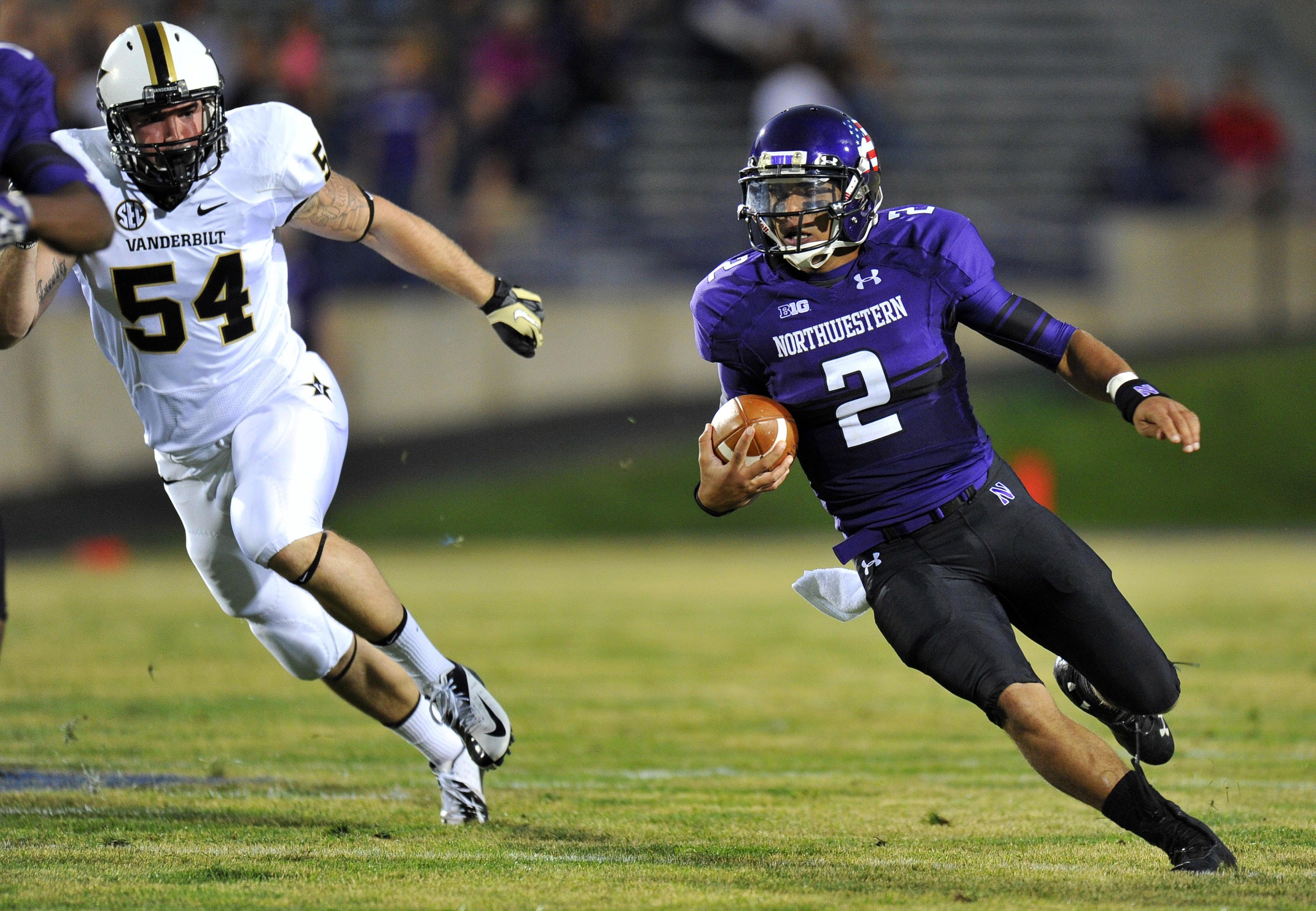 Sep 08, 2012; Evanston, IL, USA;  Northwestern Wildcats quarterback Kain Colter (2) runs the ball against the Vanderbilt Commodores during the first quarter at Ryan Field. Mandatory Credit: Mike DiNovo-US PRESSWIRE