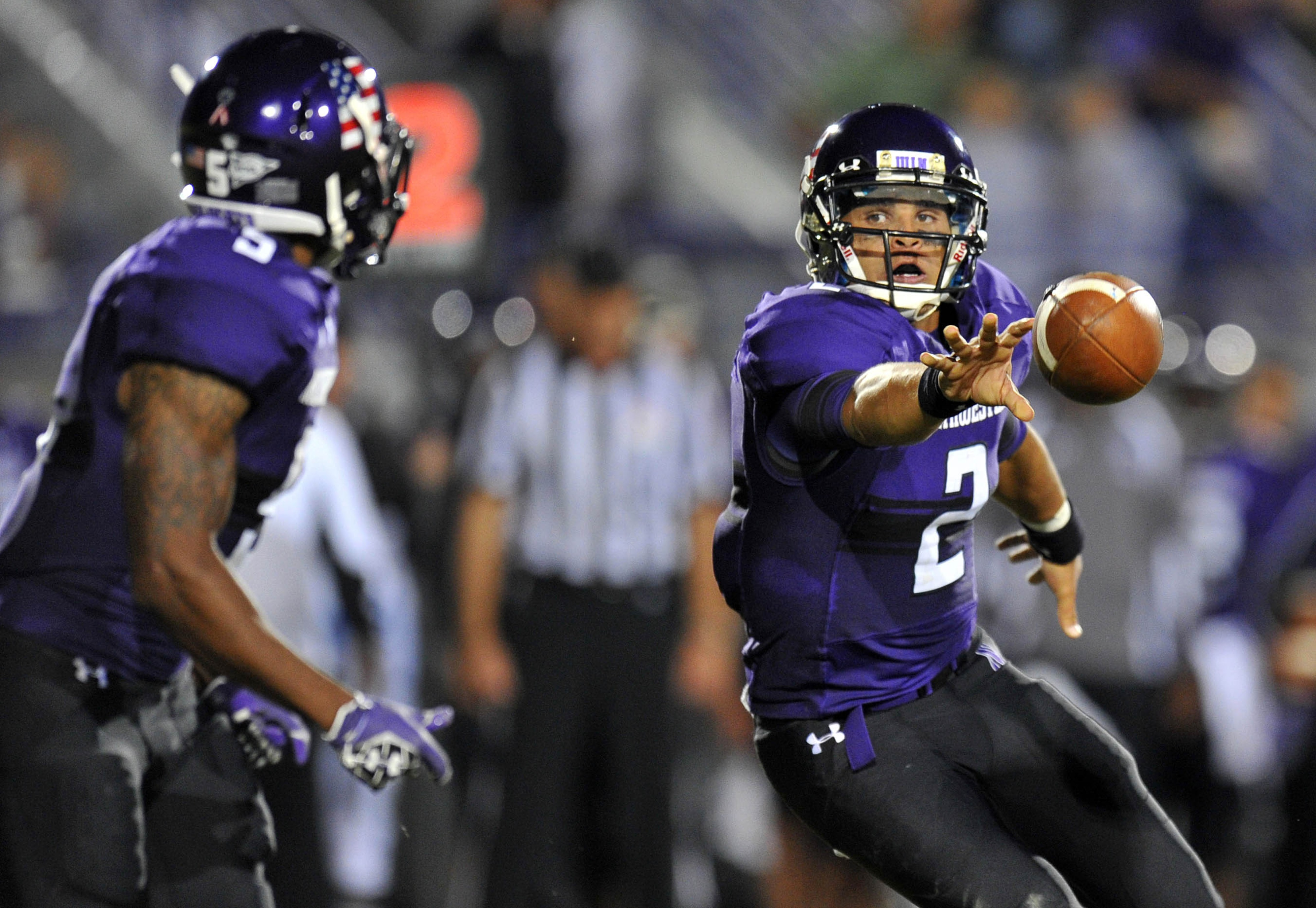 Sep 08, 2012; Evanston, IL, USA; Northwestern Wildcats quarterback Kain Colter (2) pitches the ball to running back Venric Mark (5) against the Vanderbilt Commodores during the second quarter at Ryan Field. Mandatory Credit: Mike DiNovo-US PRESSWIRE