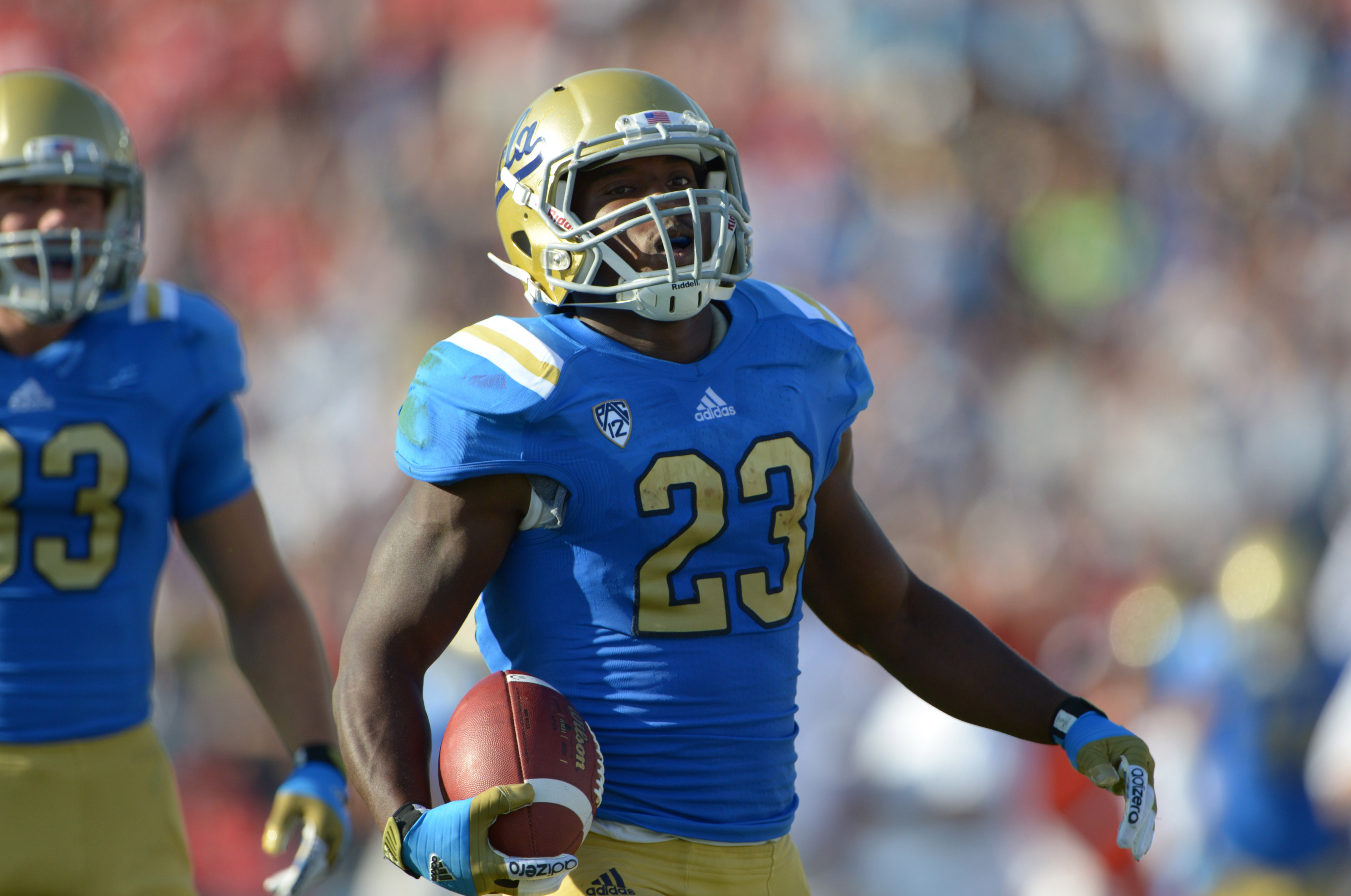 Sep 8, 2012; Pasadena, CA, USA; UCLA Bruins tailback Johnathan Franklin (23) celebrates during the game against the Nebraska Cornhuskers at the Rose Bowl. Mandatory Credit: Kirby Lee/Image of Sport-US PRESSWIRE