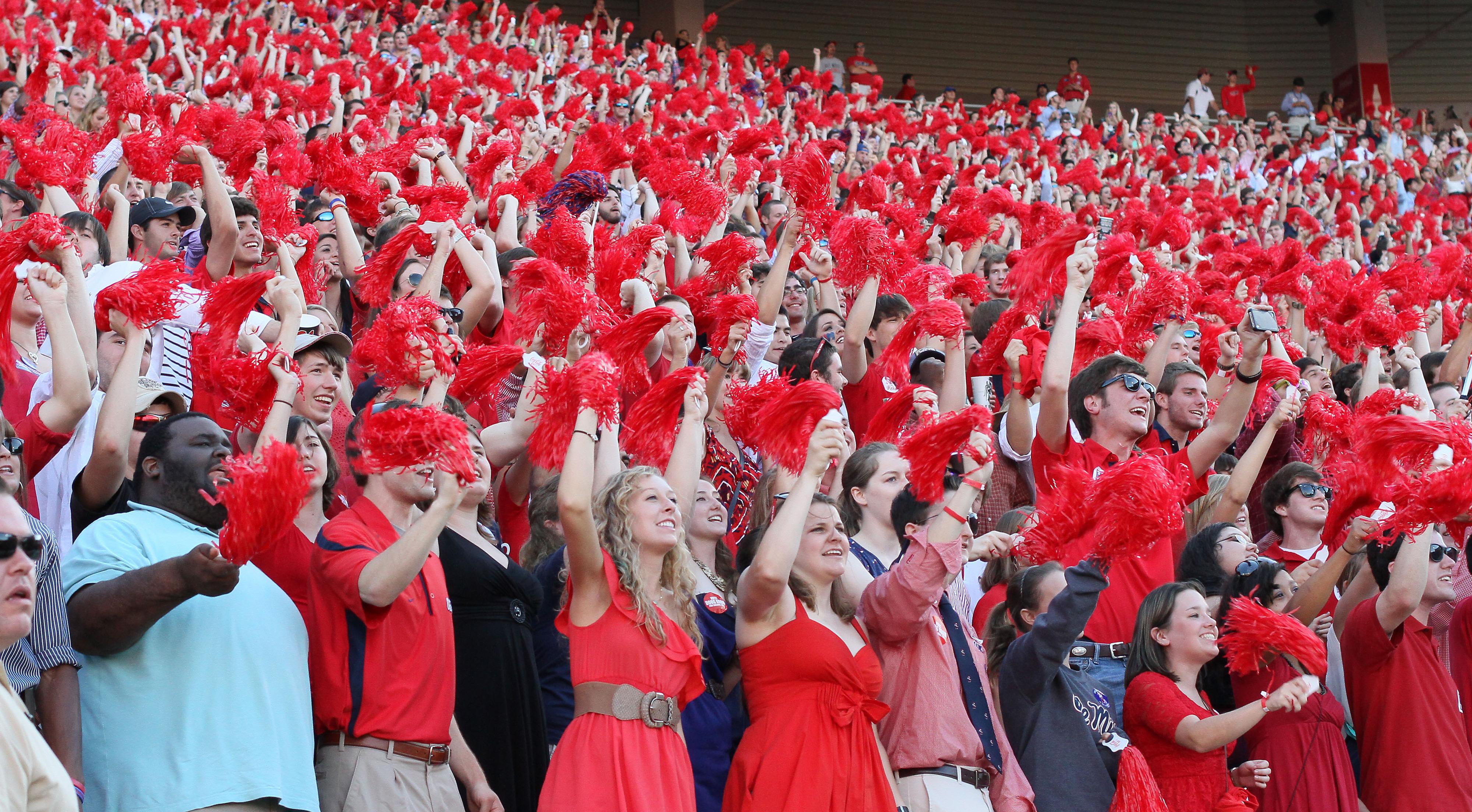 Nothing strikes fear in a Texan like a bumpkin waving a pom-pom.