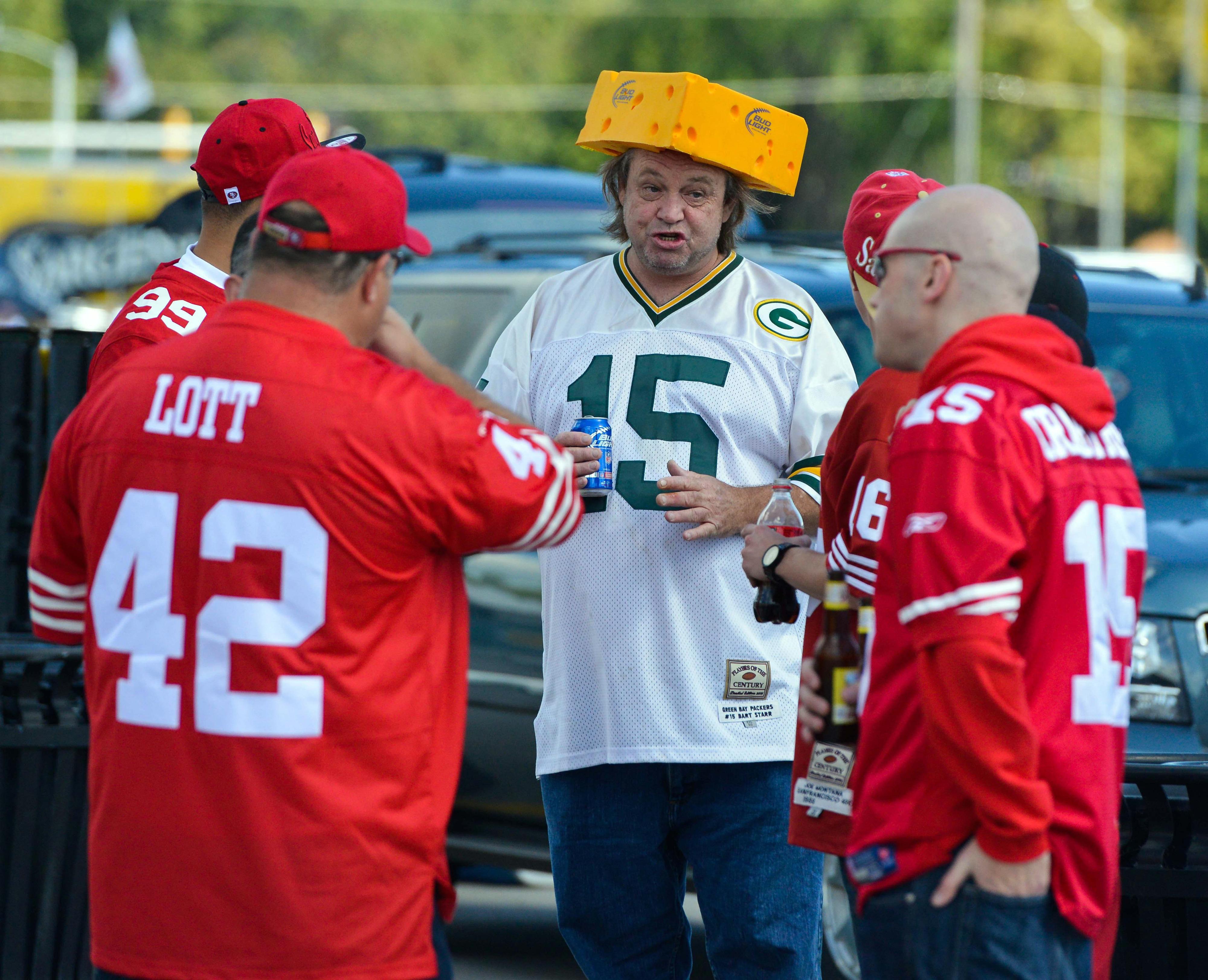 Sept 9, 2012; Green Bay, WI, USA;  Green Bay Packers fan Mike Kukielka (center) meets San Francisco 49ers fans before game at Lambeau Field.  Mandatory Credit: Benny Sieu-US PRESSWIRE