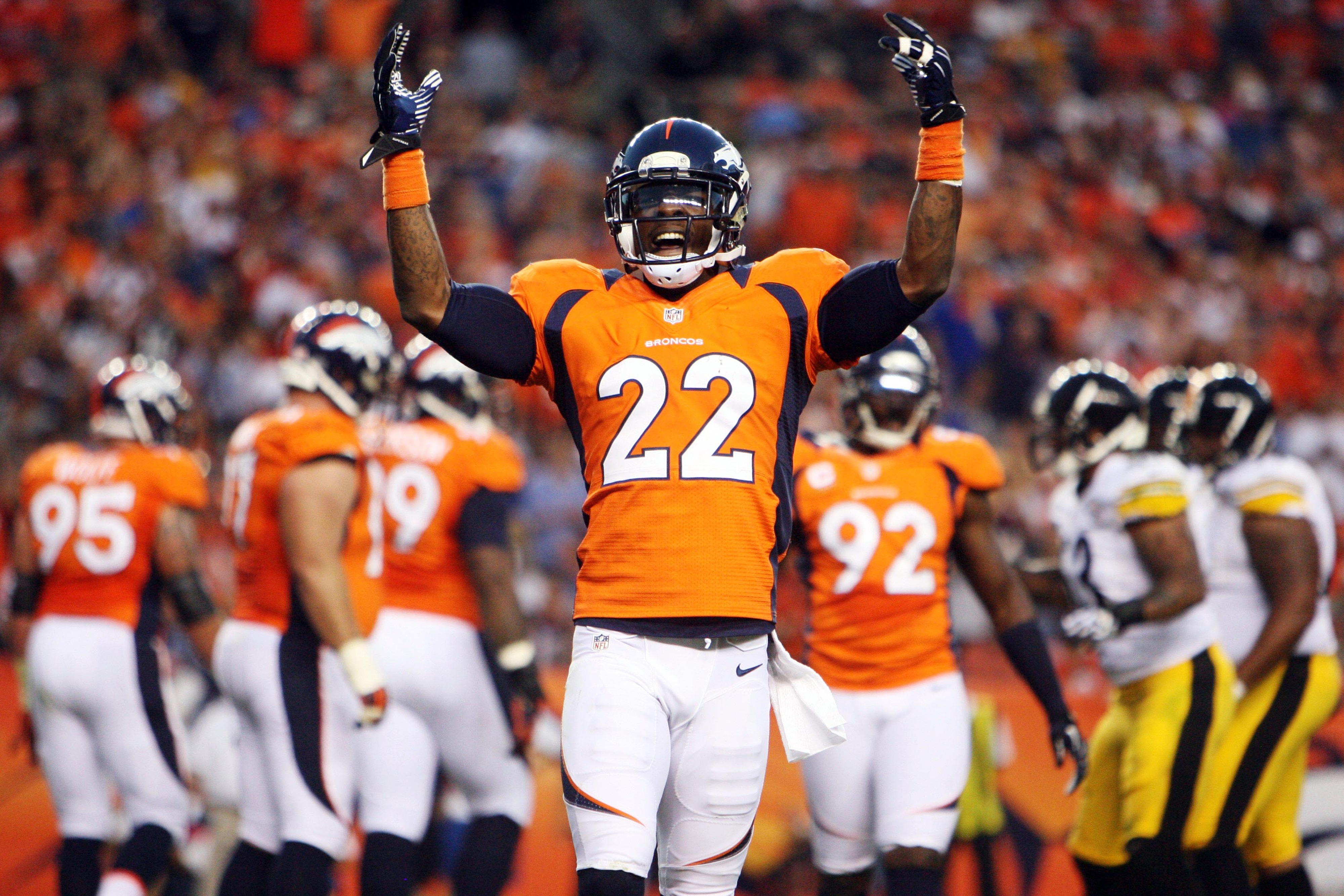 September 9, 2012; Denver, CO, USA; Denver Broncos cornerback Tracy Porter (22) celebrates during the first half against the Pittsburgh Steelers at Sports Authority Field at Mile High.  Mandatory Credit: Chris Humphreys-US PRESSWIRE