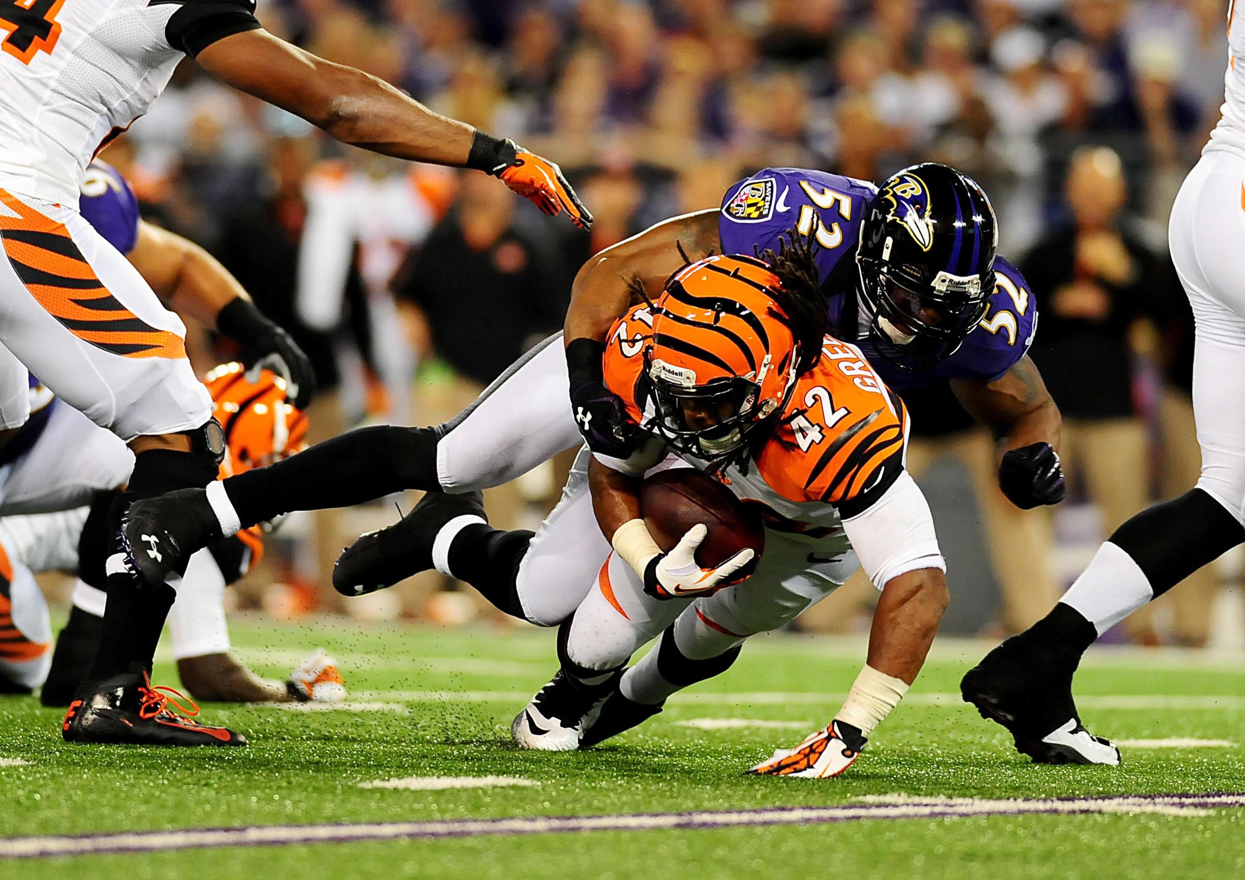 September 10, 2012; Baltimore, MD, USA; Cincinnati Bengals running back BenJarvus Green-Ellis (42) gets tackled by Baltimore Ravens linebacker Ray Lewis (52) at M&T Bank Stadium. Mandatory Credit: Evan Habeeb-US PRESSWIRE