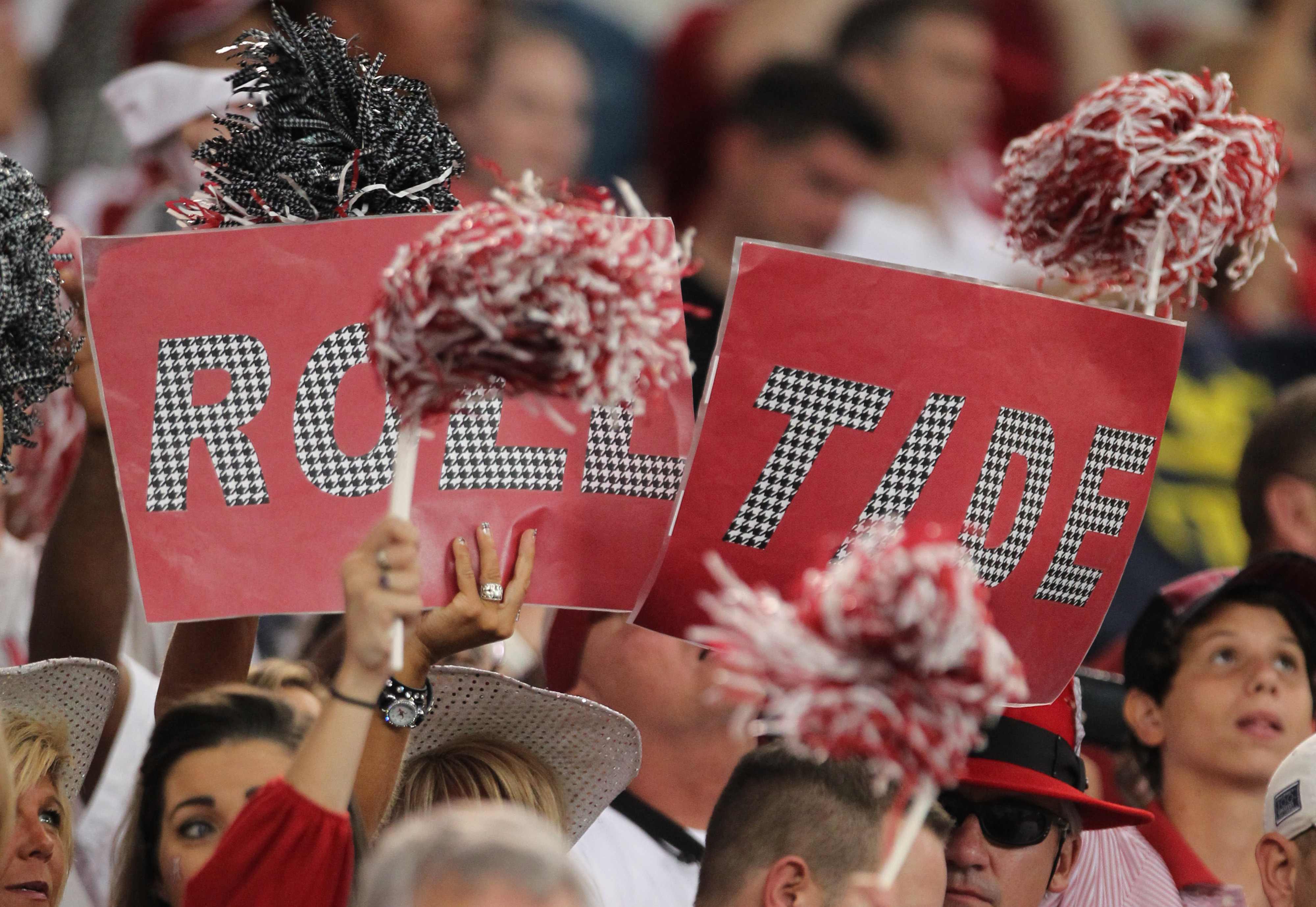 Sep 1, 2012; Arlington, TX, USA; Alabama Crimson Tide fans hold a sign  for roll tide during the game against the Michigan Wolverines at Cowboys Stadium. Mandatory Credit: Matthew Emmons-US PRESSWIRE