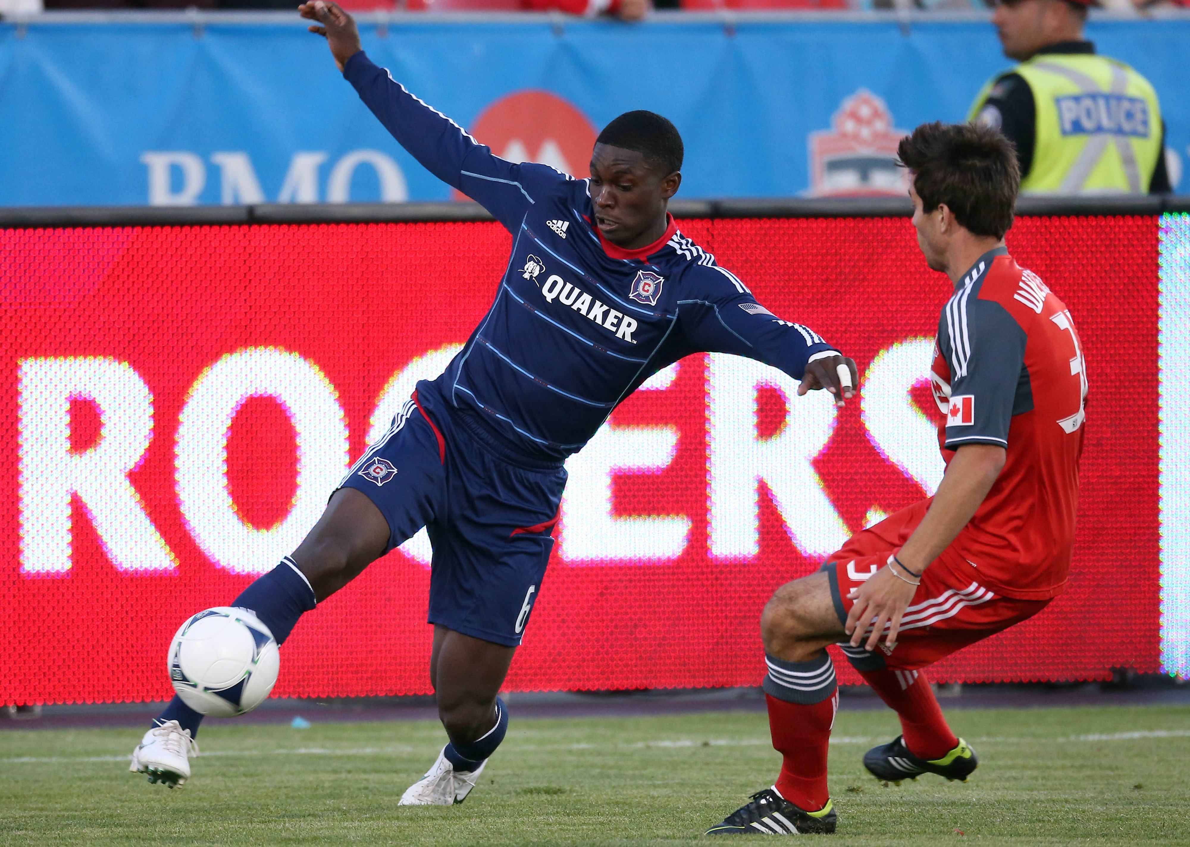 Sep 12, 2012; Toronto, ON, Canada; Chicago Fire defender Jalil Anibaba (6) tries to settle the ball against Toronto FC forward Andrew Wiedeman (32) at BMO Field. The Fire beat the FC 2-1. Mandatory Credit: Tom Szczerbowski-US PRESSWIRE