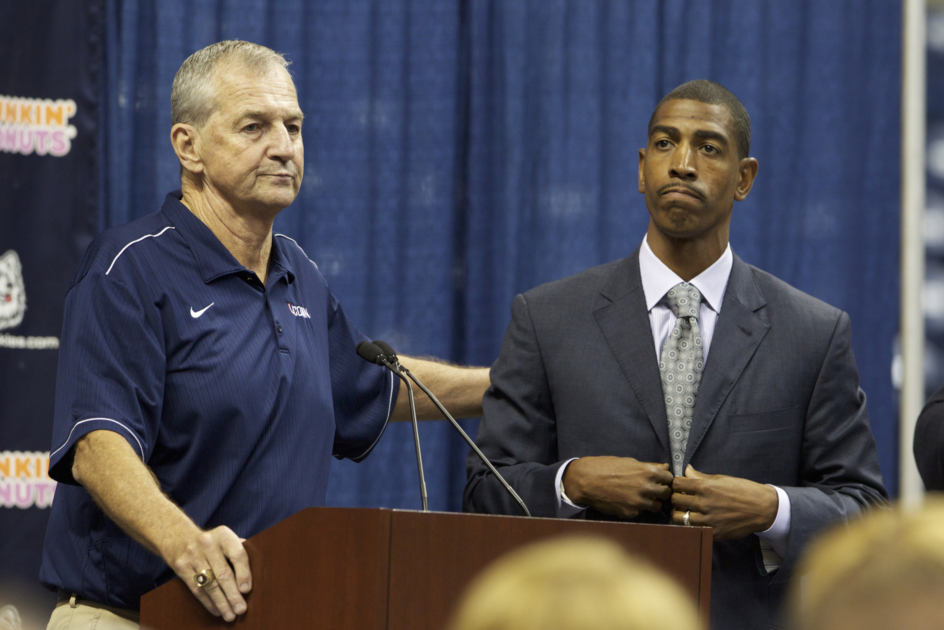 We know what the guy on the left has done - how do we evaluate that replacement coach to his right? How does any school replace a legend?