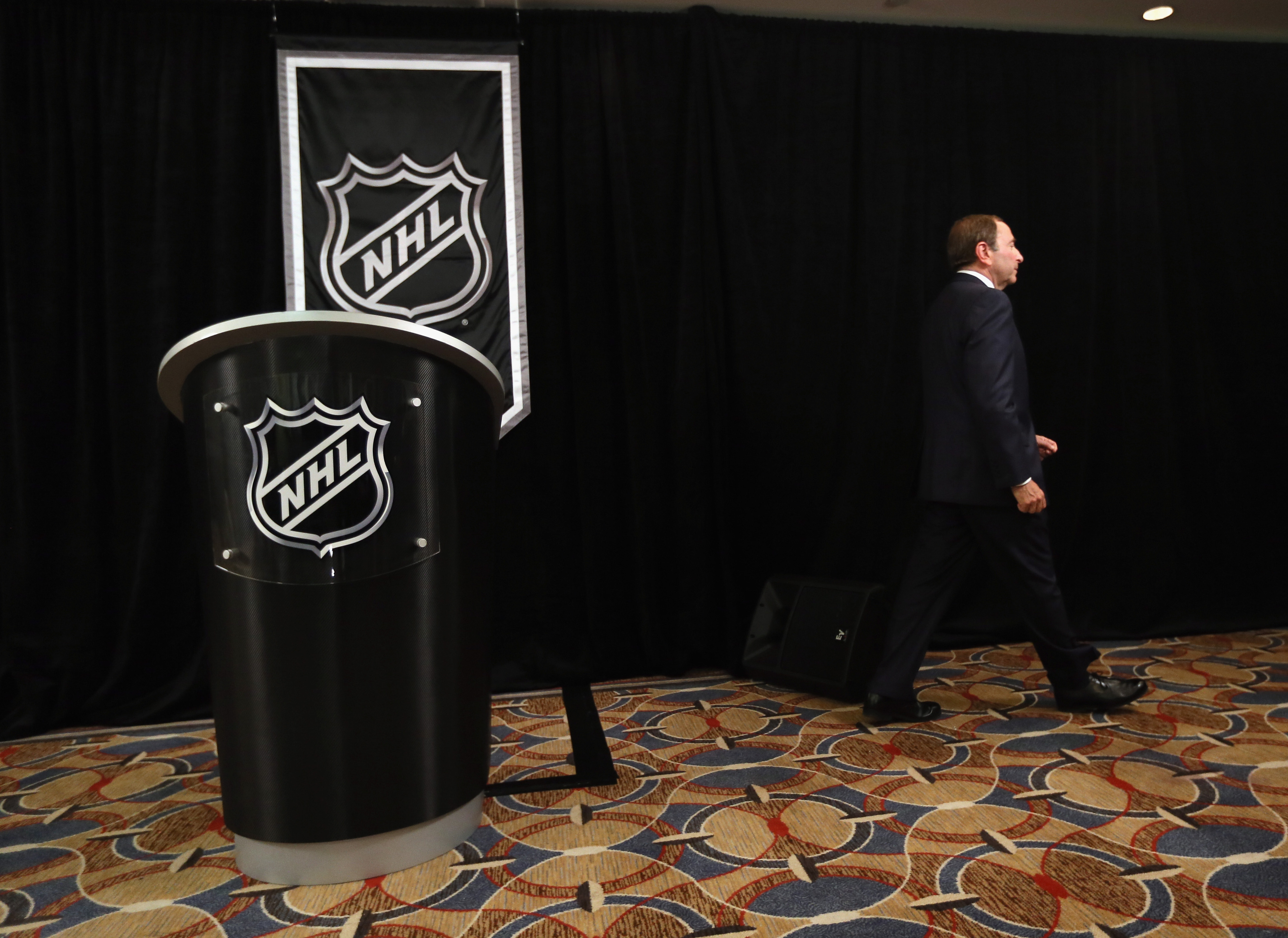 NEW YORK, NY - SEPTEMBER 13:  Commissioner Gary Bettman of the National Hockey League leaves the podium after addressing the media at Crowne Plaza Times Square on September 13, 2012 in New York City.  (Photo by Bruce Bennett/Getty Images)