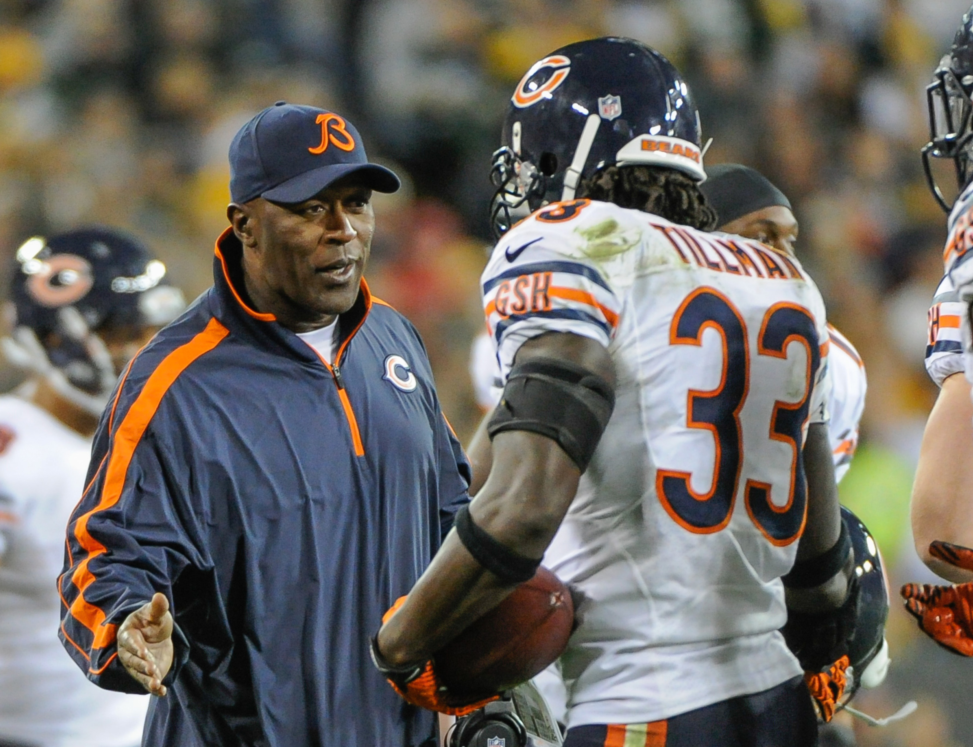 Sept 13, 2012; Green Bay, WI, USA;   Chicago Bears head coach Lovie Smith greets cornerback Charles Tillman (33) after a fumble recovery against the Green Bay Packers at Lambeau Field.  Mandatory Credit: Benny Sieu-US PRESSWIRE