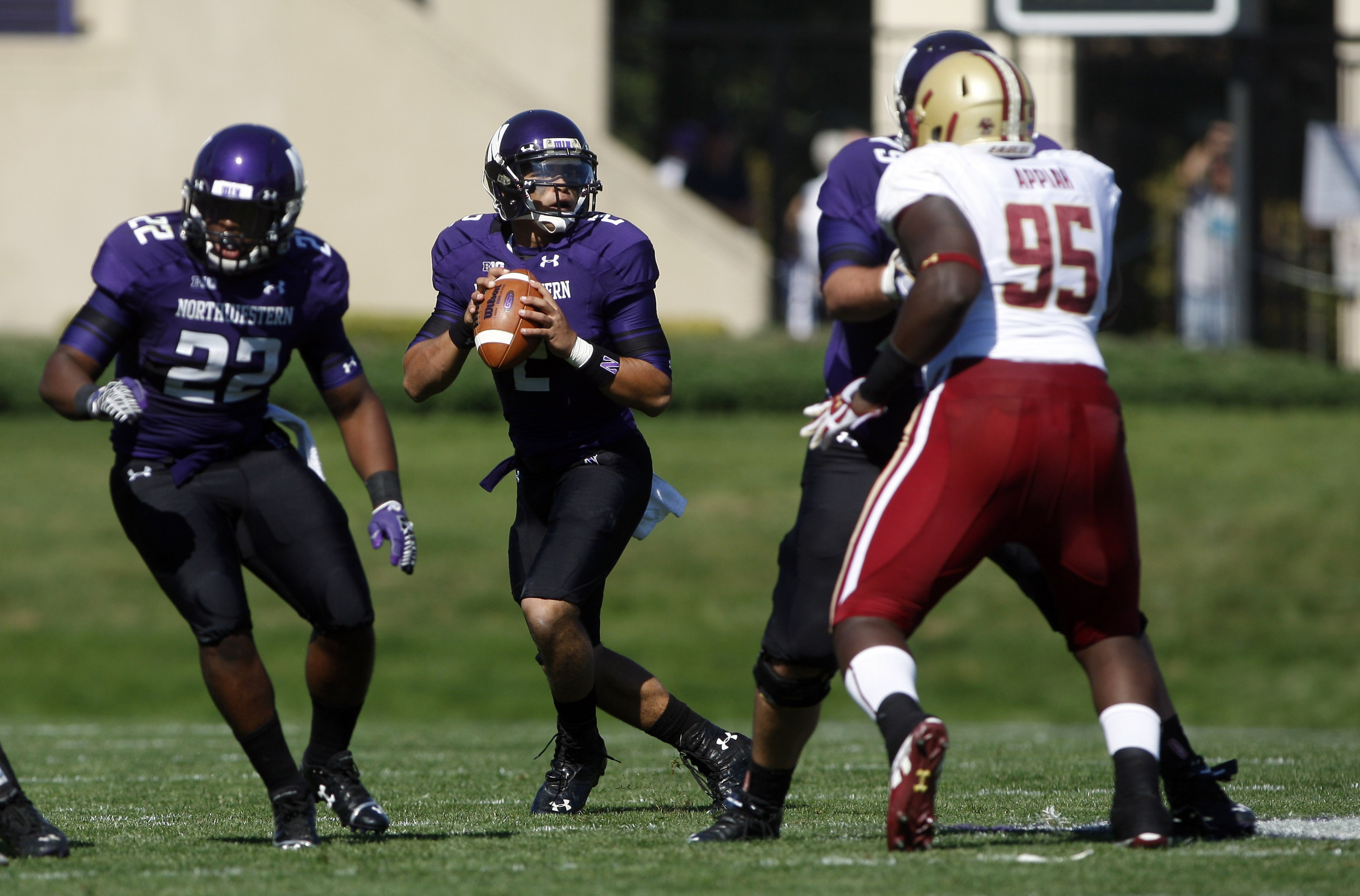 Sep 15, 2012; Evanston, IL, USA; Northwestern Wildcats quarterback Kain Colter (2) drops back to pass against the Boston College Eagles during the first quarter at Ryan Field.  Mandatory Credit: Jerry Lai-US PRESSWIRE