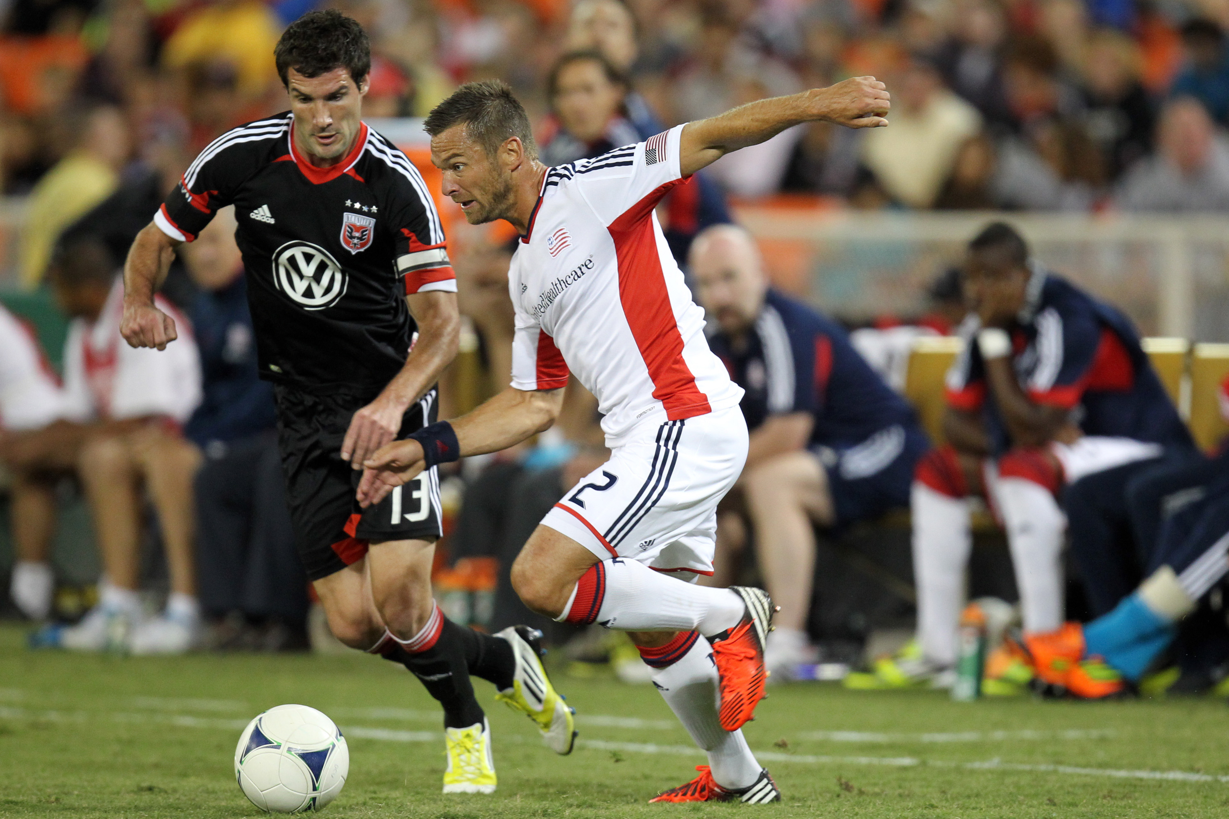 WASHINGTON, DC - SEPTEMBER 15: Florian Lechner #2 of the New England Revolution controls the ball against Chris Pontius #13 of D.C. United at RFK Stadium on September 15, 2012 in Washington, DC.(Photo by Ned Dishman/Getty Images)