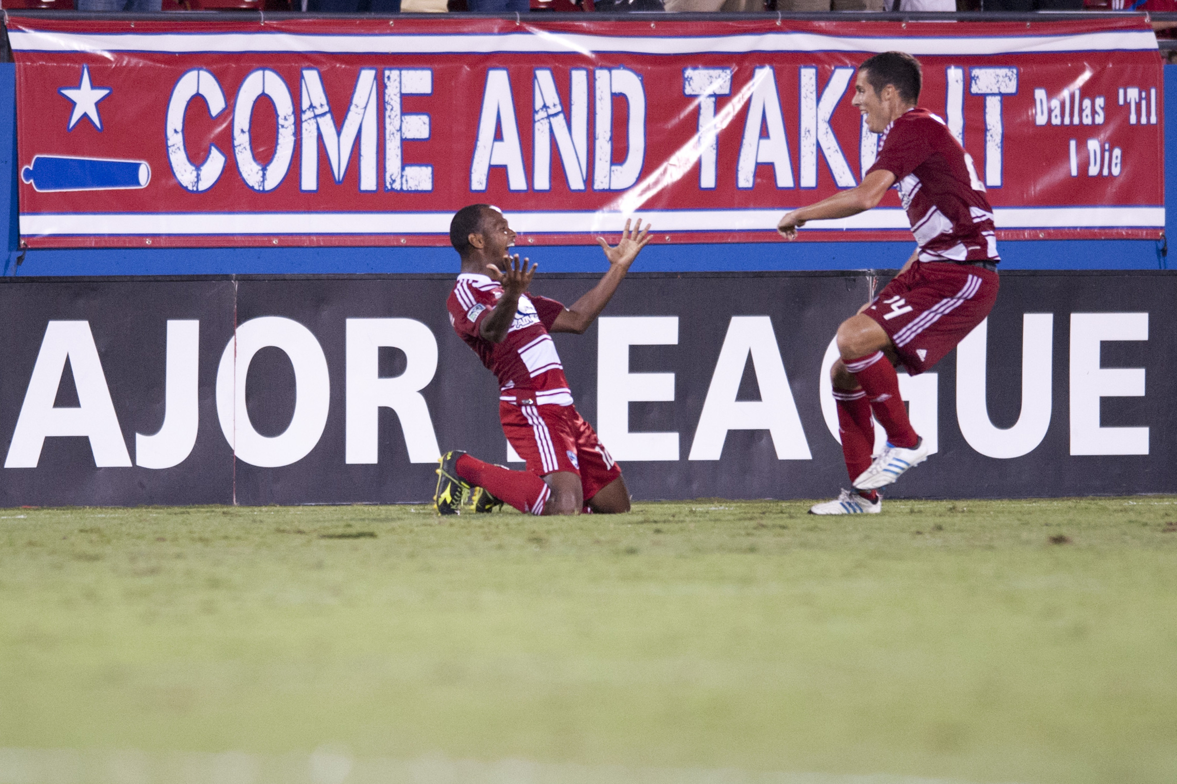 FRISCO, TX - SEPTEMBER 15:  Julian de Guzman #12 of FC Dallas celebrates the game winning goal with teammates against the Vancouver Whitecaps FC on September 15, 2012 at FC Dallas Stadium in Frisco, Texas.  (Photo by Cooper Neill/Getty Images)