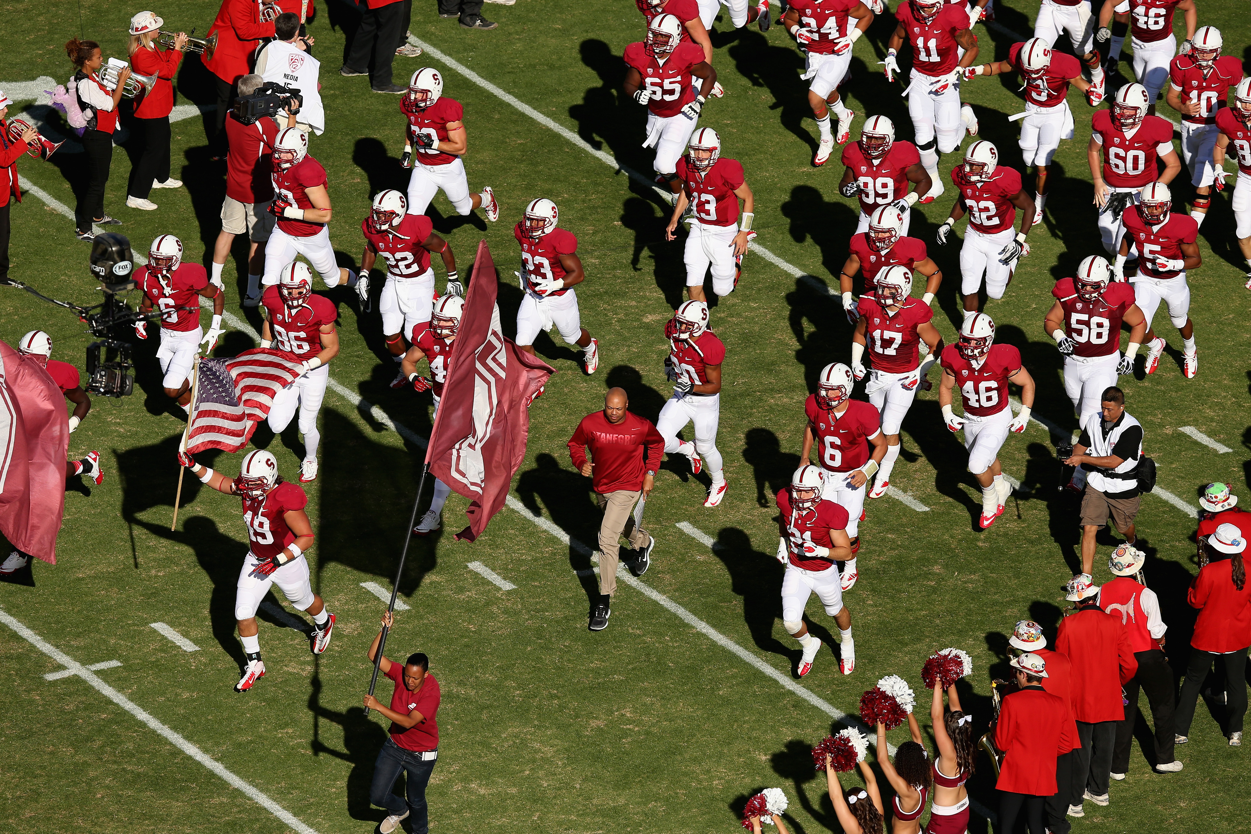 PALO ALTO, CA - SEPTEMBER 15:  Stanford Cardinal head coach David Shaw runs on to the field with his team before their game against the USC Trojans at Stanford Stadium on September 15, 2012 in Palo Alto, California.  (Photo by Ezra Shaw/Getty Images)