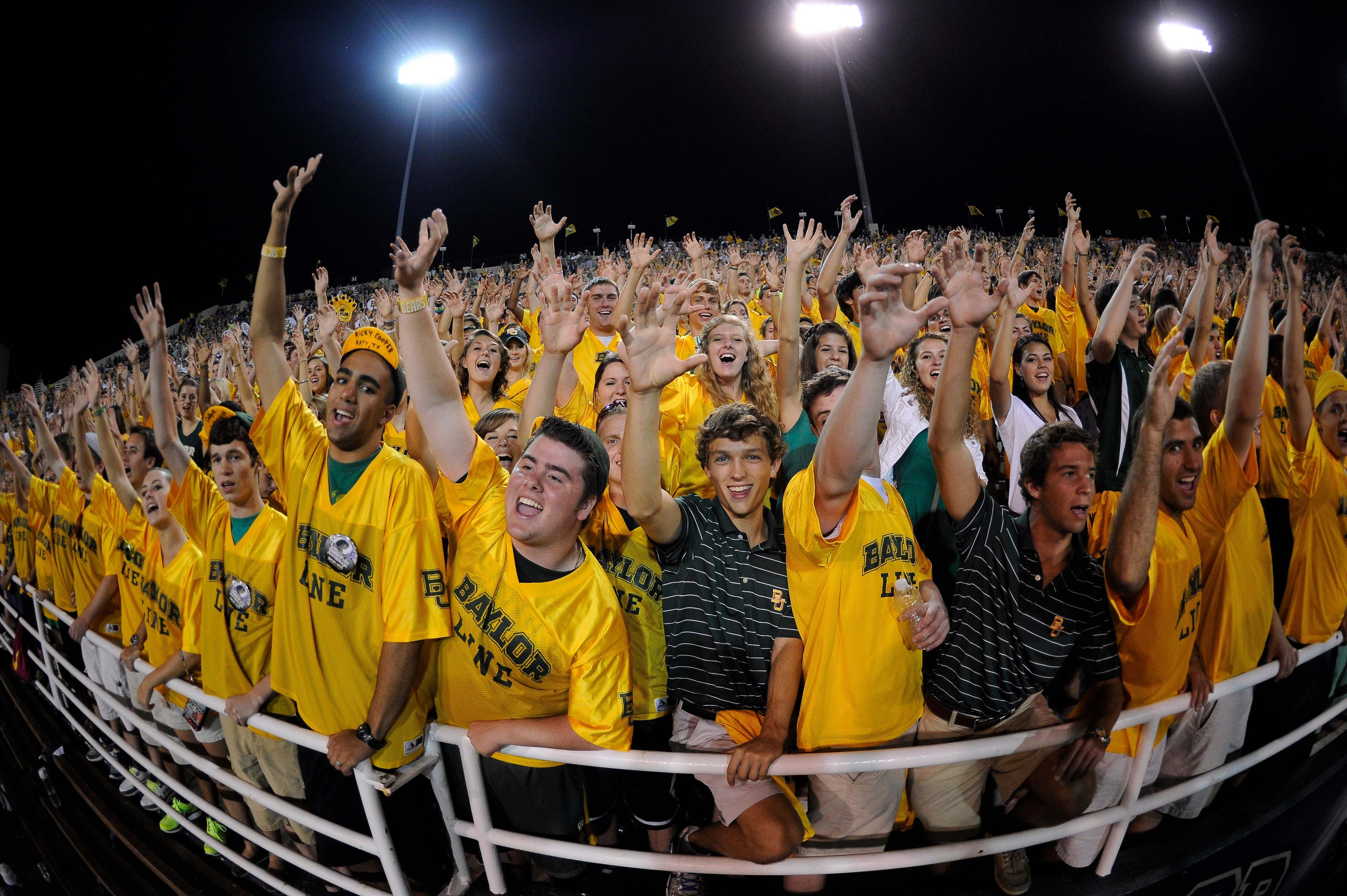 Sep 15, 2012; Waco, TX, USA; Baylor Bears students root for their team as they face the Sam Houston State Bearkats during the fourth quarter at Floyd Casey Stadium. The Bears defeated the Bearkats 43-28. Mandatory Credit: Jerome Miron-US PRESSWIRE