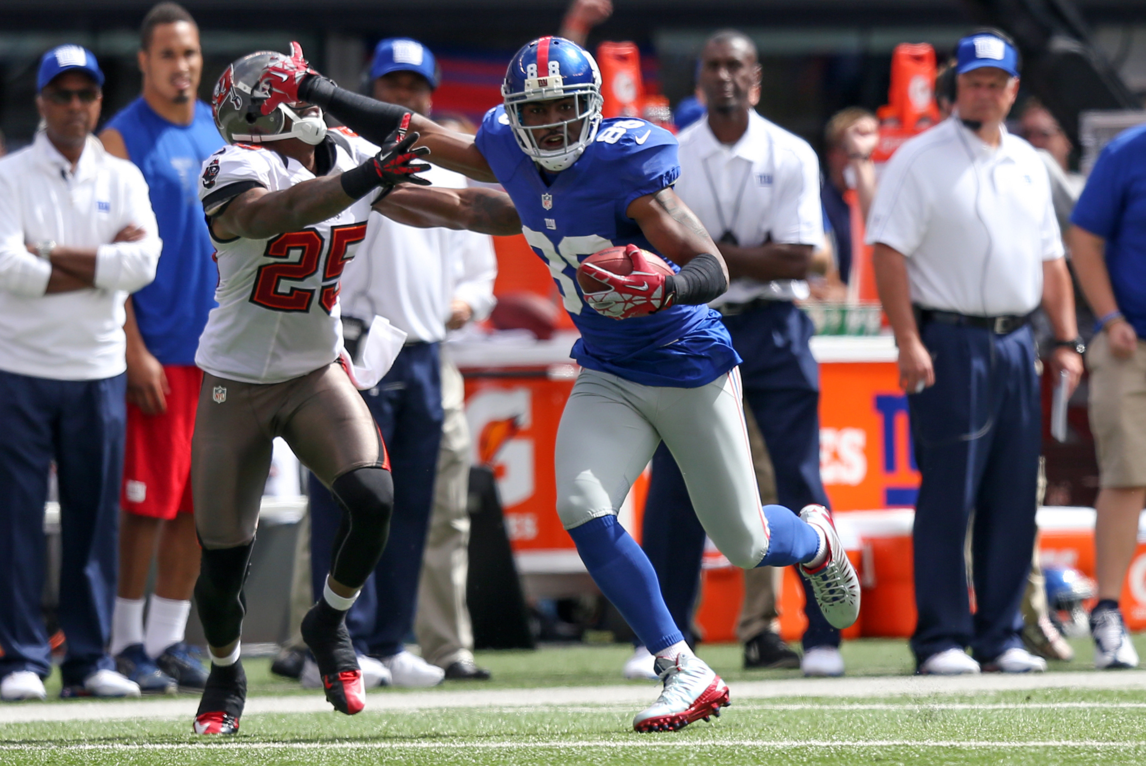 Sep 16, 2012; East Rutherford, NJ, New York Giants wide receiver Hakeem Nicks (88) holds off Tampa Bay Buccaneers cornerback Aqib Talib (25) during the first quarter at MetLife Stadium. Mandatory Credit: Anthony Gruppuso-US PRESSWIRE