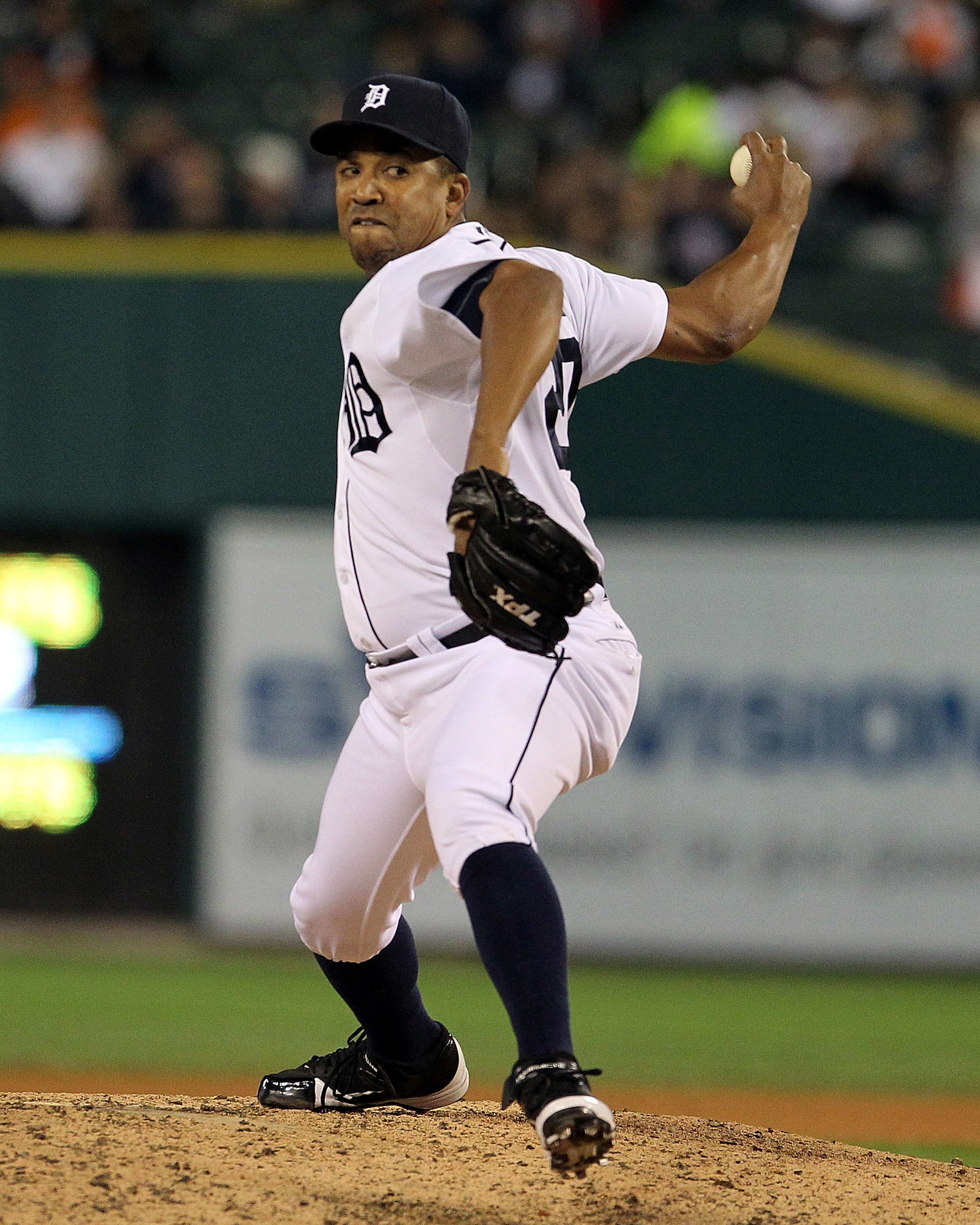 DETROIT, MI - SEPTEMBER 19:  Octavio Dotel #20 of the Detroit Tigers pitches in the seventh inning against the Oakland Athletics at Comerica Park on September 19, 2012 in Detroit, Michigan.  The Tigers won 6-2.  (Photo by Dave Reginek/Getty Images)