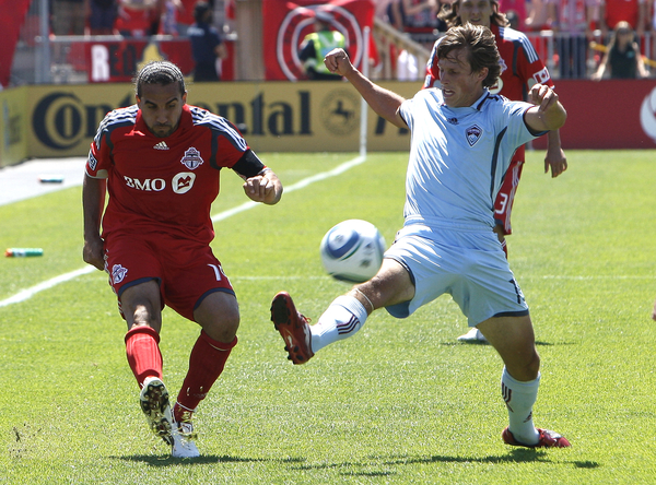 TORONTO - JULY 10: Dwayne De Rosario #14 of the Toronto FC battes with Wells Thompson #15 of the Colorado Rapids during a MLS game at BMO Field July 10 2010 in Toronto Ontario Canada. (Photo by Abelimages/Getty Images)