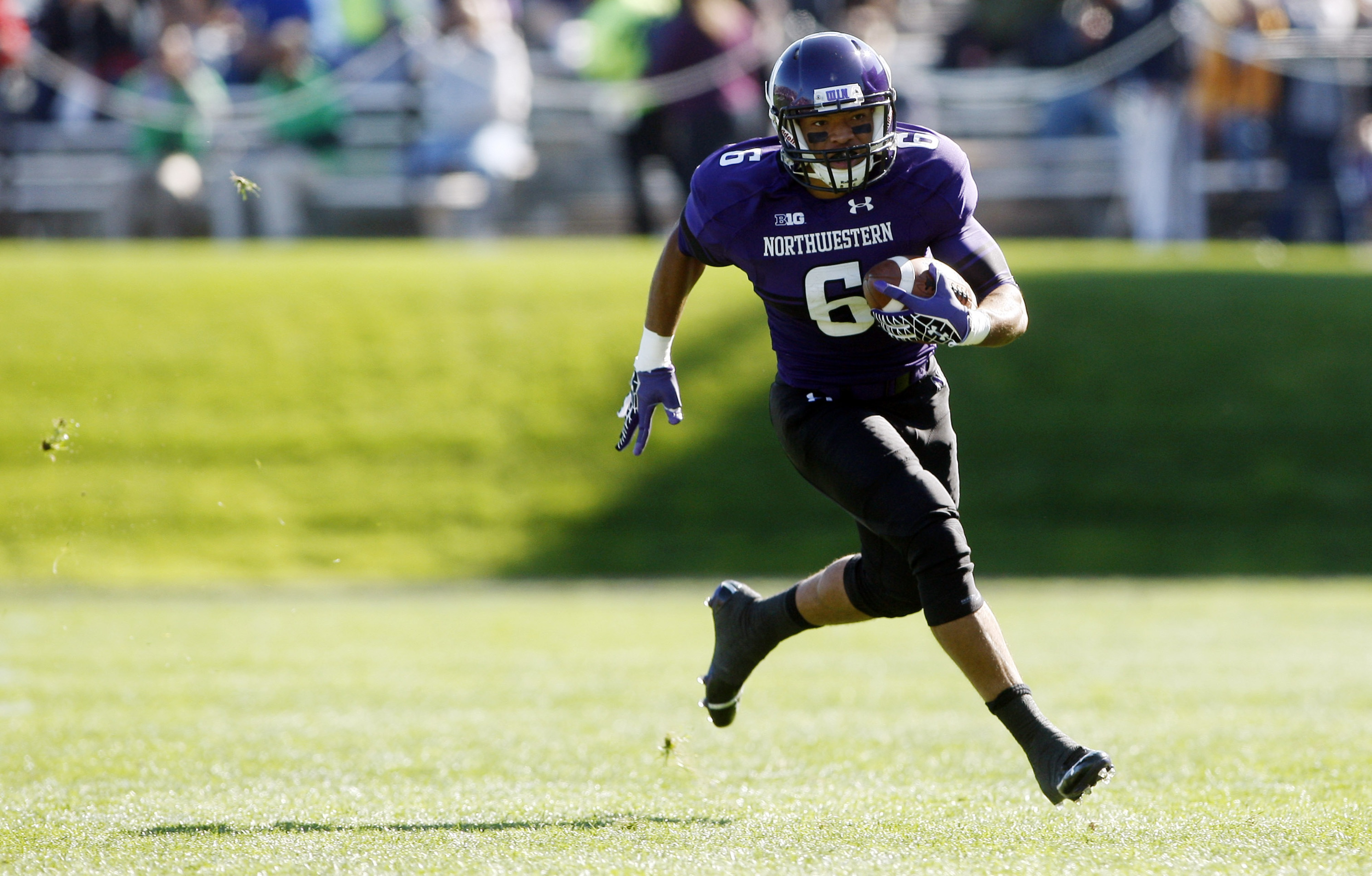 Sep 22, 2012; Evanston, IL, USA; Northwestern Wildcats wide receiver Tony Jones (6) runs after making a catch against the South Dakota Coyotes during the first quarter at Ryan Field.  Mandatory Credit: Jerry Lai-US PRESSWIRE