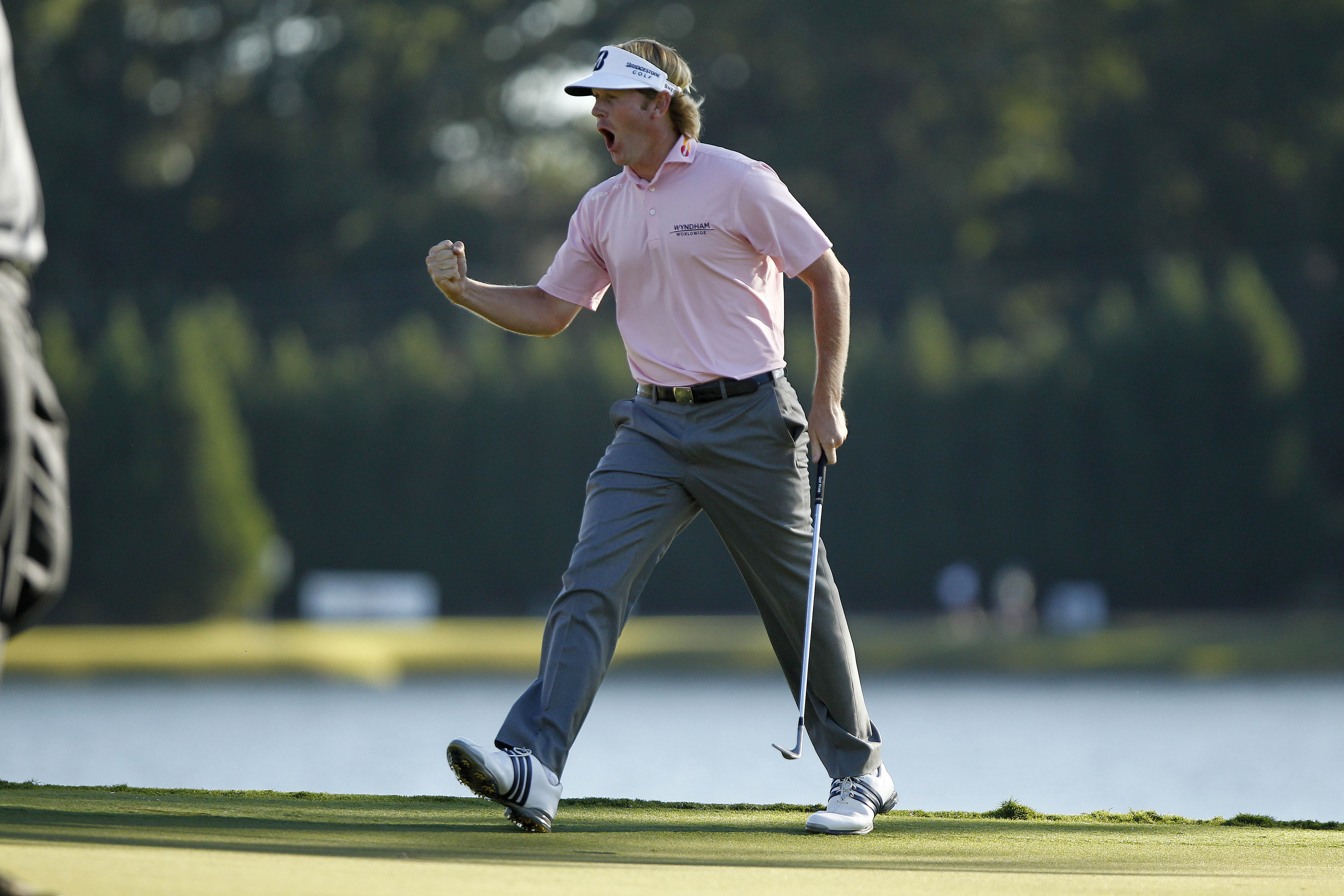 Sep 23, 2012; Atlanta, GA, USA; Brandt Snedeker (USA) celebrates hitting a birdie on the 17th hole during the final round of the TOUR Championship at East Lake Golf Club. Mandatory Credit: Debby Wong-US PRESSWIRE