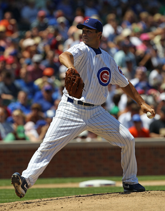 Starting pitcher Ted Lilly of the Chicago Cubs delivers the ball against the Philadelphia Phillies at Wrigley Field in Chicago Illinois. The Cubs defeated the Phillies 4-3. (Photo by Jonathan Daniel/Getty Images)