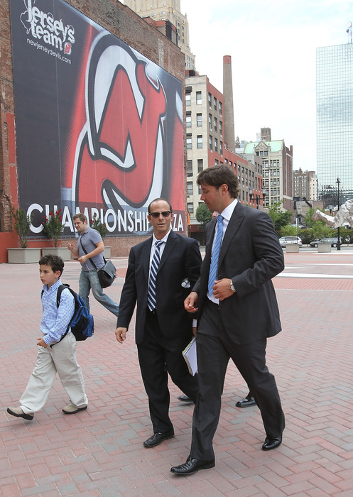 NEWARK NJ - JULY 20:(L-R) Agent Jay Grossman, Ilya Kovalchuk and NHLPA lawyer (left) chat en route to arbitration hearings  (Photo by Bruce Bennett/Getty Images)