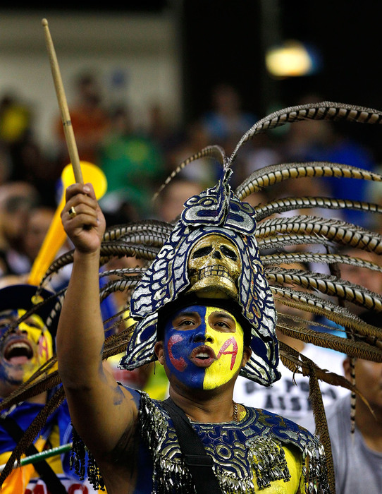 ATLANTA - JULY 28:  A fan of Club America cheers during the match against Manchester City during the 2010 Aaron's International Soccer Challenge match at Georgia Dome on July 28 2010 in Atlanta Georgia.  (Photo by Kevin C. Cox/Getty Images)