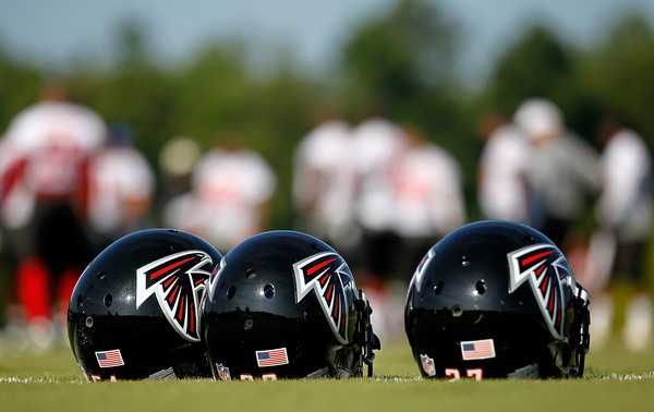 FLOWERY BRANCH GA - JULY 30:  Helmets sit on the ground during the Atlanta Falcons workout on opening day of training camp on July 30 2010 at the Falcons Training Complex in Flowery Branch Georgia.  (Photo by Kevin C. Cox/Getty Images)