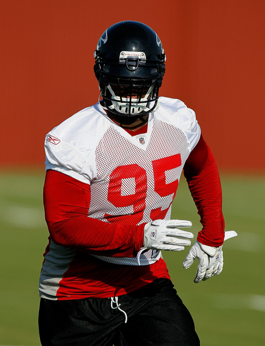 FLOWERY BRANCH GA - JULY 30:  Jonathan Babineaux #95 of the Atlanta Falcons runs drills during opening day of training camp on July 30 2010 at the Falcons Training Complex in Flowery Branch Georgia.  (Photo by Kevin C. Cox/Getty Images)