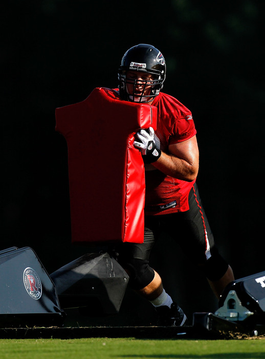 FLOWERY BRANCH GA - JULY 30:  Todd McClure #62 of the Atlanta Falcons runs sled drills during opening day of training camp on July 30 2010 at the Falcons Training Complex in Flowery Branch Georgia.  (Photo by Kevin C. Cox/Getty Images)