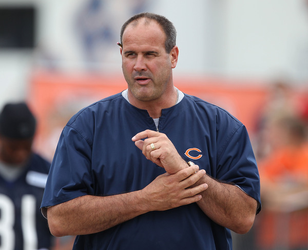 BOURBONNAIS IL - JULY 30: Offensive line coach Mike Tice of the Chicago Bears walks out for a summer training camp practice at Olivet Nazarene University on July 30 2010 in Bourbonnais Illinois. (Photo by Jonathan Daniel/Getty Images)