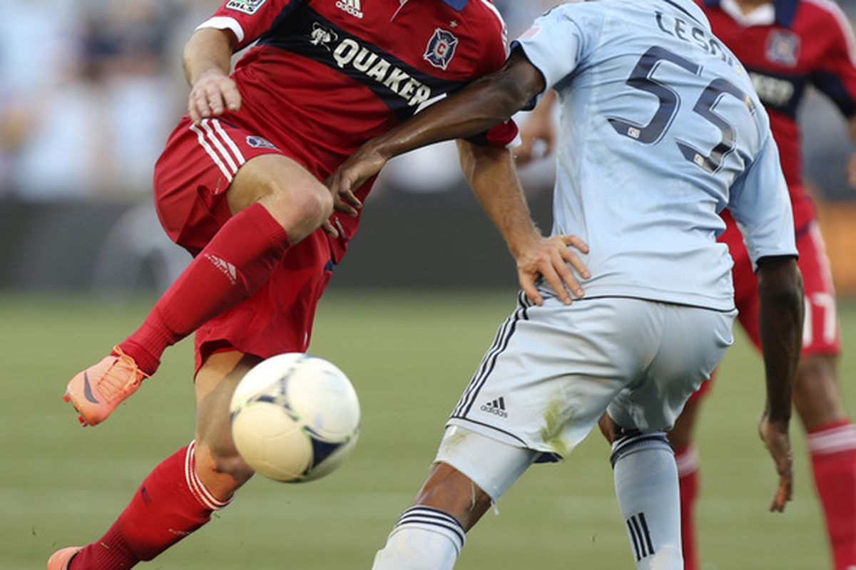 KANSAS CITY, KS - JUNE 29:  Chris Rolfe #18 of Chicago Fire tries to pass around Julio Cesar #55 of Sporting Kansas City in the first half at Livestrong Sporting Park on June 29, 2012 in Kansas City, Kansas. (Photo by Ed Zurga/Getty Images)